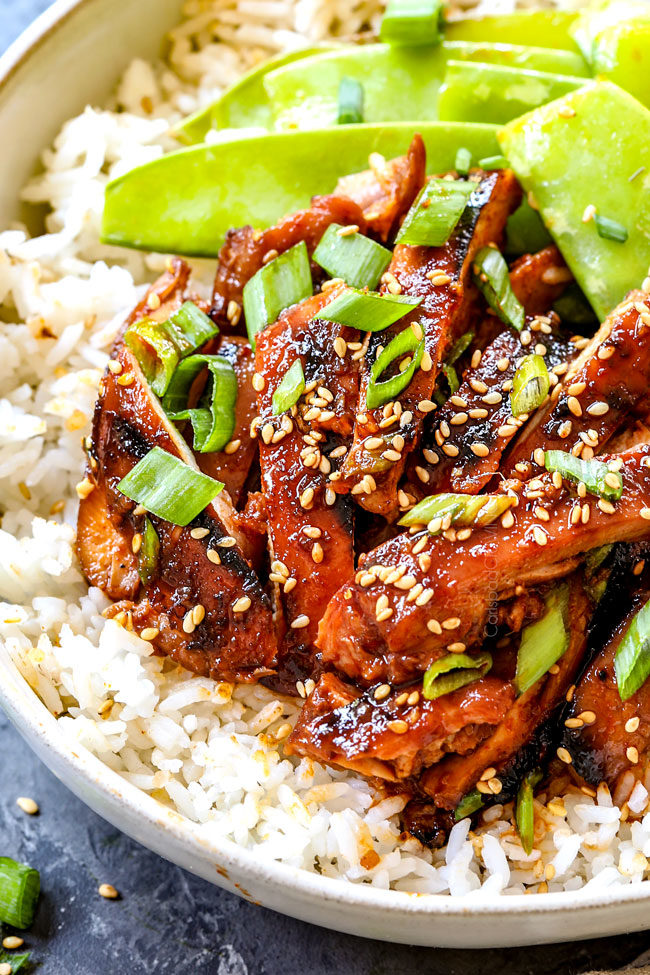 showing how to serve Korean Chicken with sliced up Korean Spicy Chicken over rice
