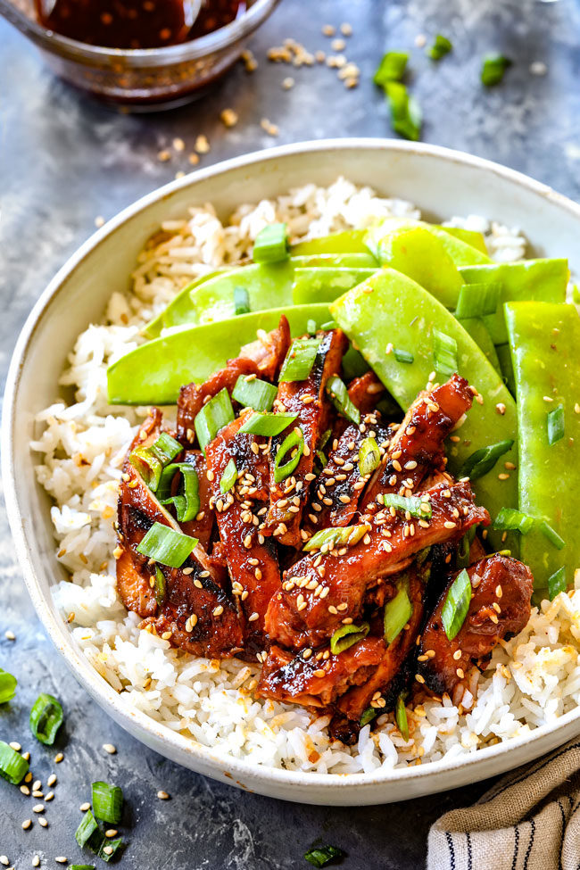 showing what sided to serve with Korean BBQ Chicken by placing chicken in a bowl with rice