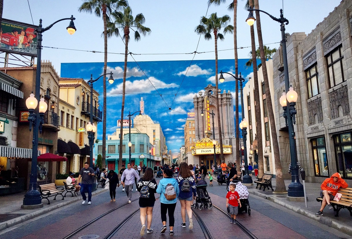 Disneyland without a car includes walking down a fake street in Hollywood.