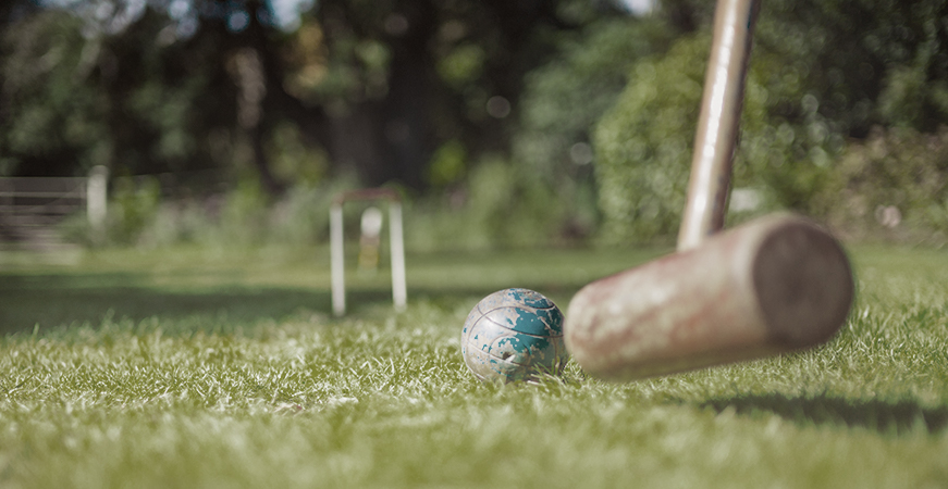 Close up of playing croquet at a picnic.