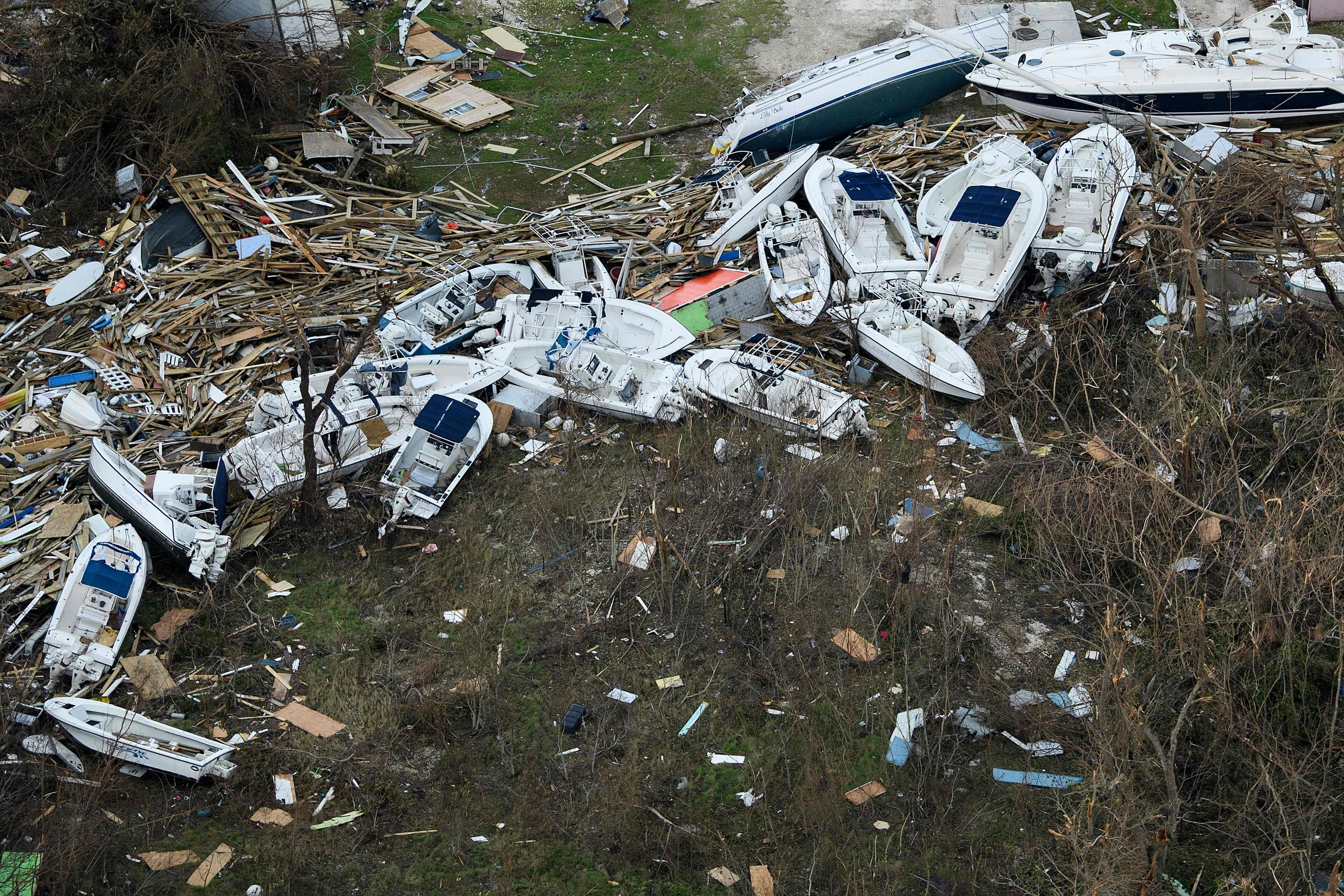 Boats are piled where they were hurled by the storm in Great Abaco, Bahamas