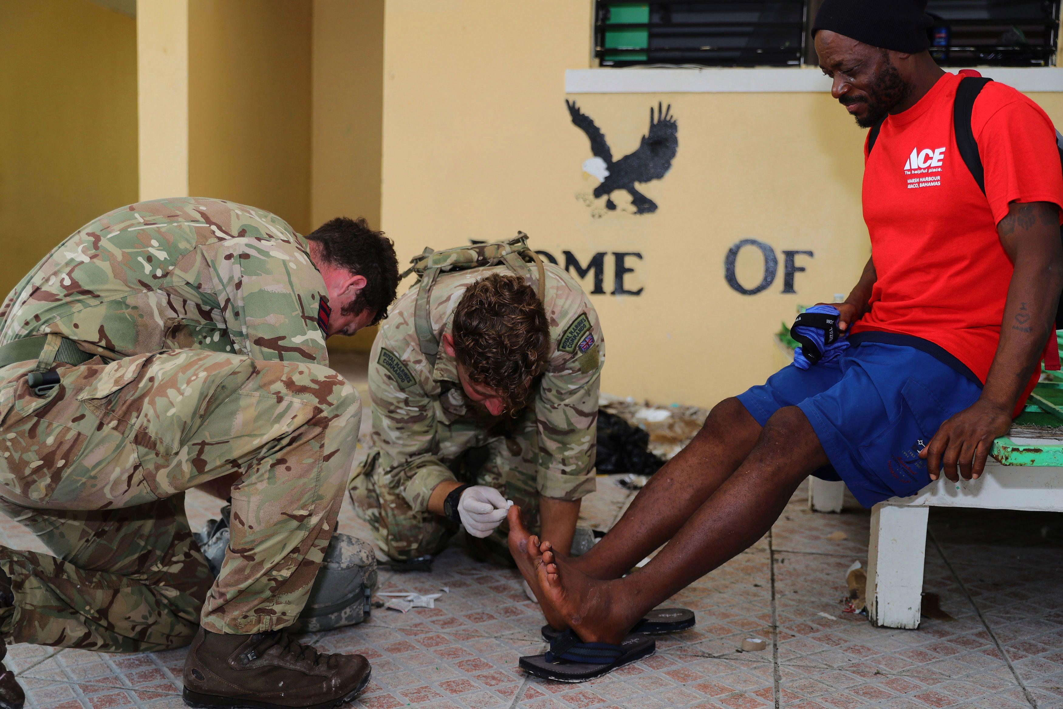 Brit servicemen provide medical treatment to one man after Hurricane Dorian