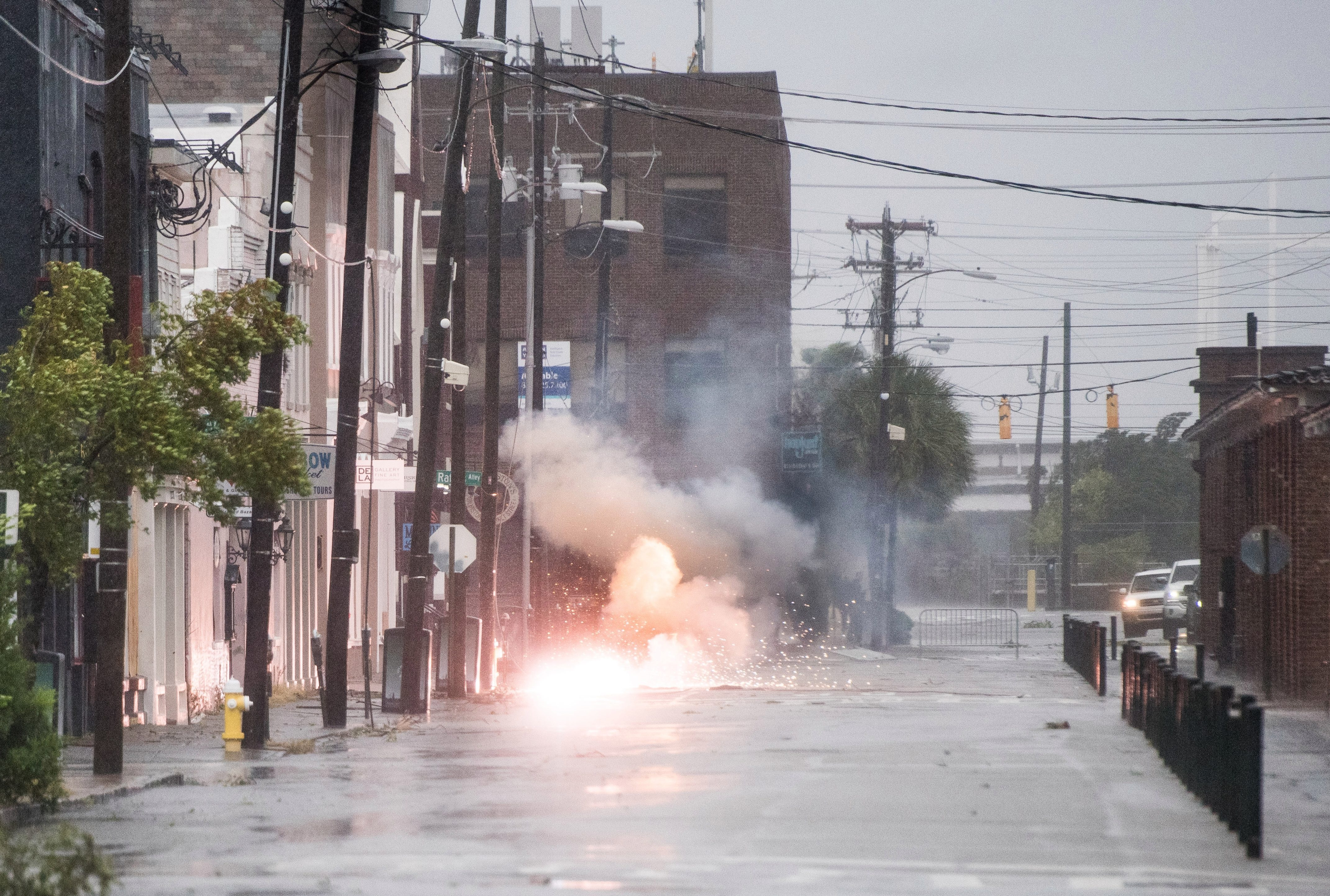Power lines spark in flood water in Charleston, South Carolina
