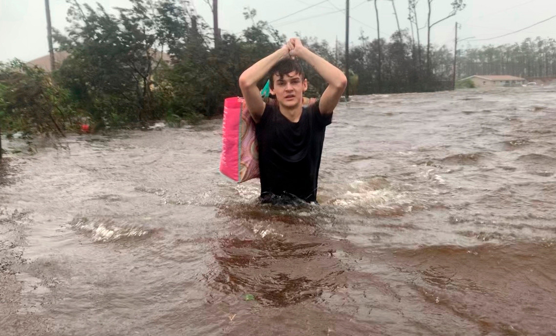 Matthew Aylen is rescued from a flooded home in Freeport, Bahamas