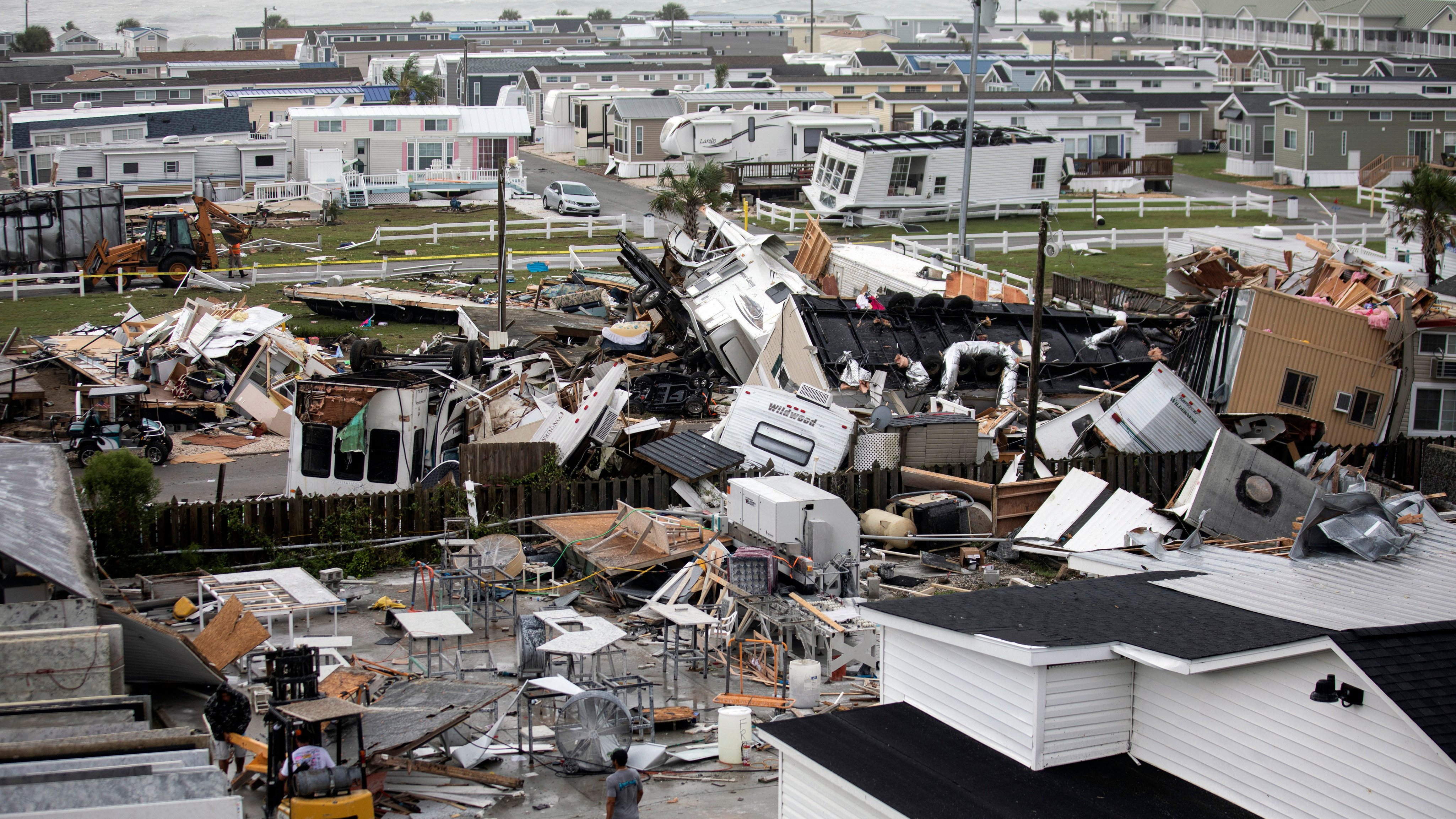 Mobile homes are upended and debris is strewn about at the Holiday Trav-l Park in North Carolina