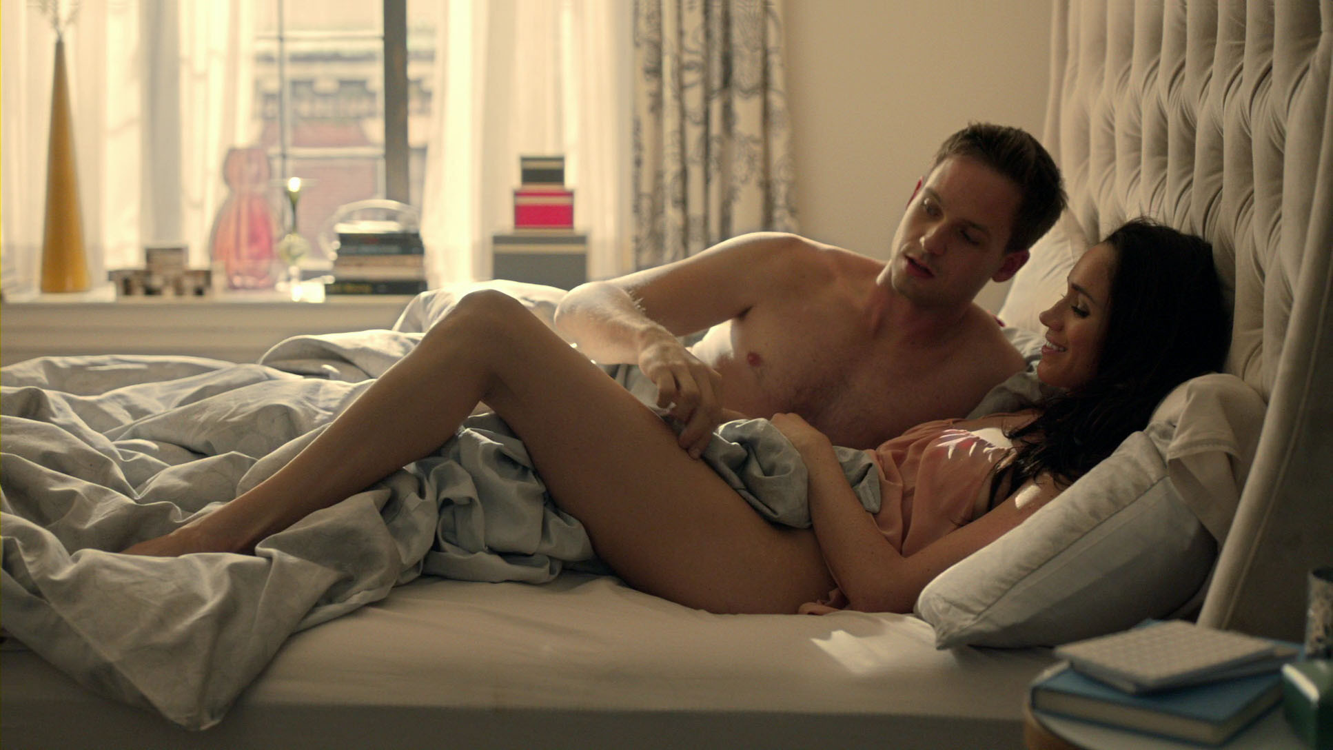 One of Meghan's racy scenes in US drama Suits with actor Patrick J Adams