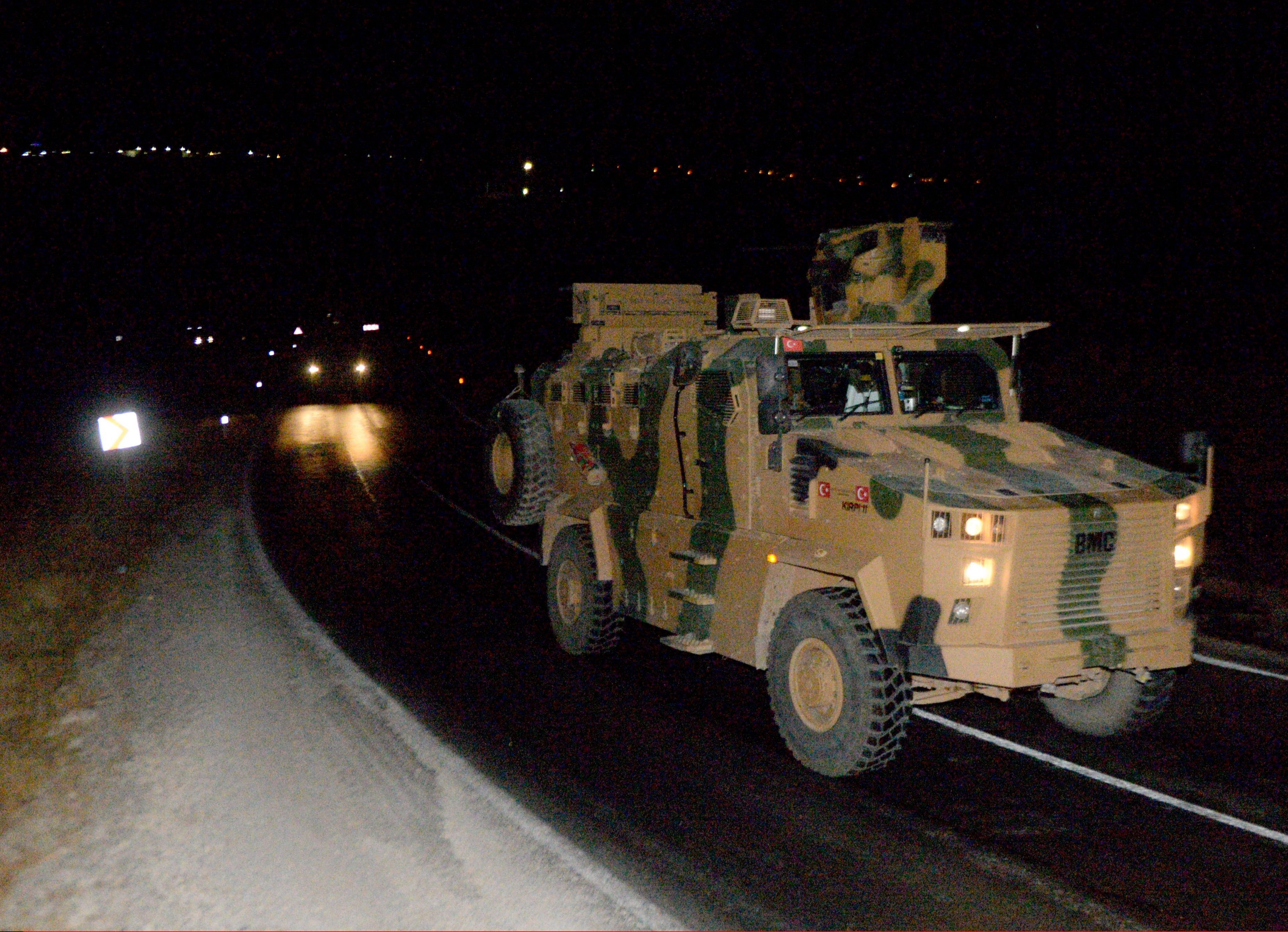 Turkish Armed Forces' armoured vehicles carrying commandos move towards the Syrian border