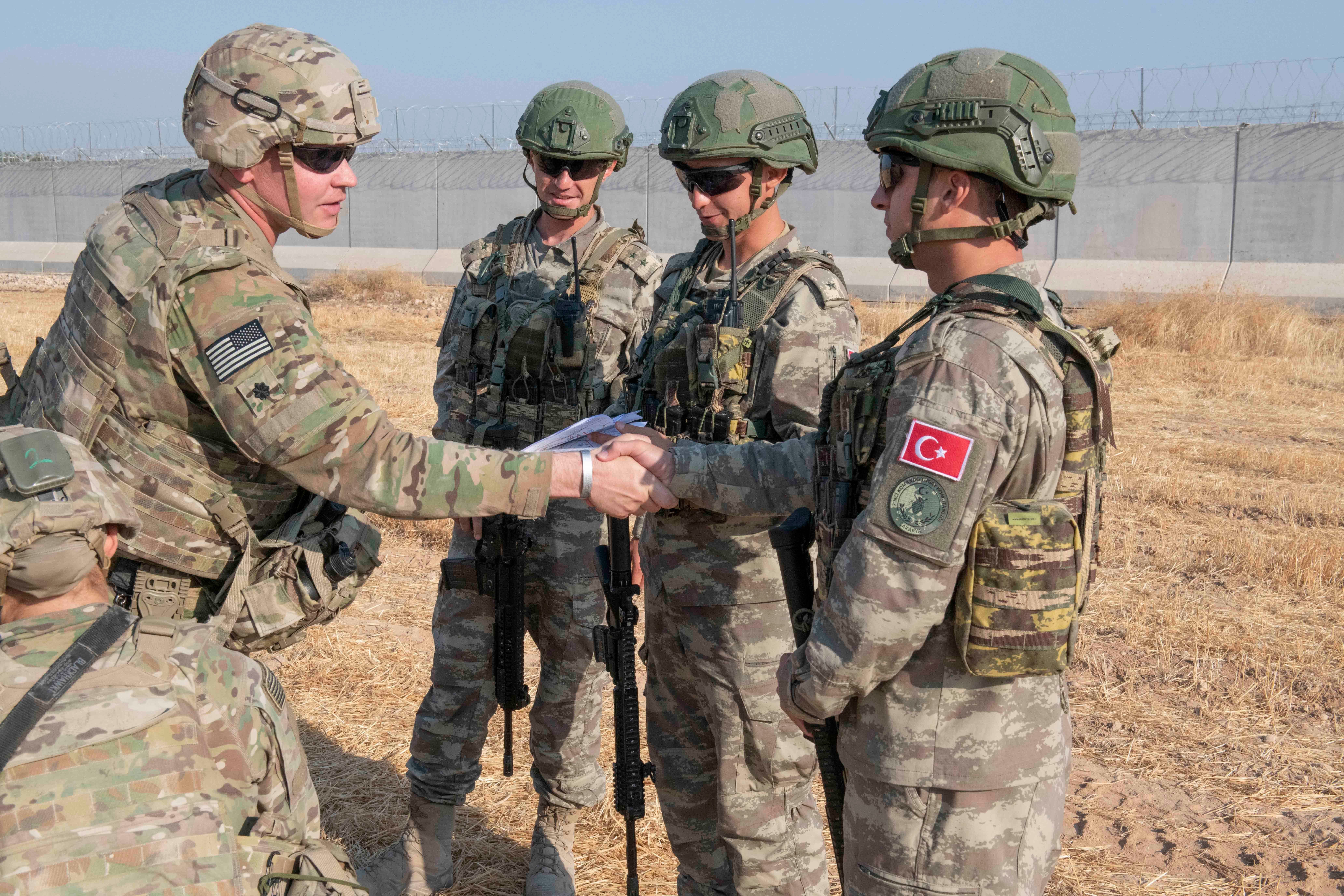 US and Turkish military forces conducting joint patrols inside northeast Syria at the weekend