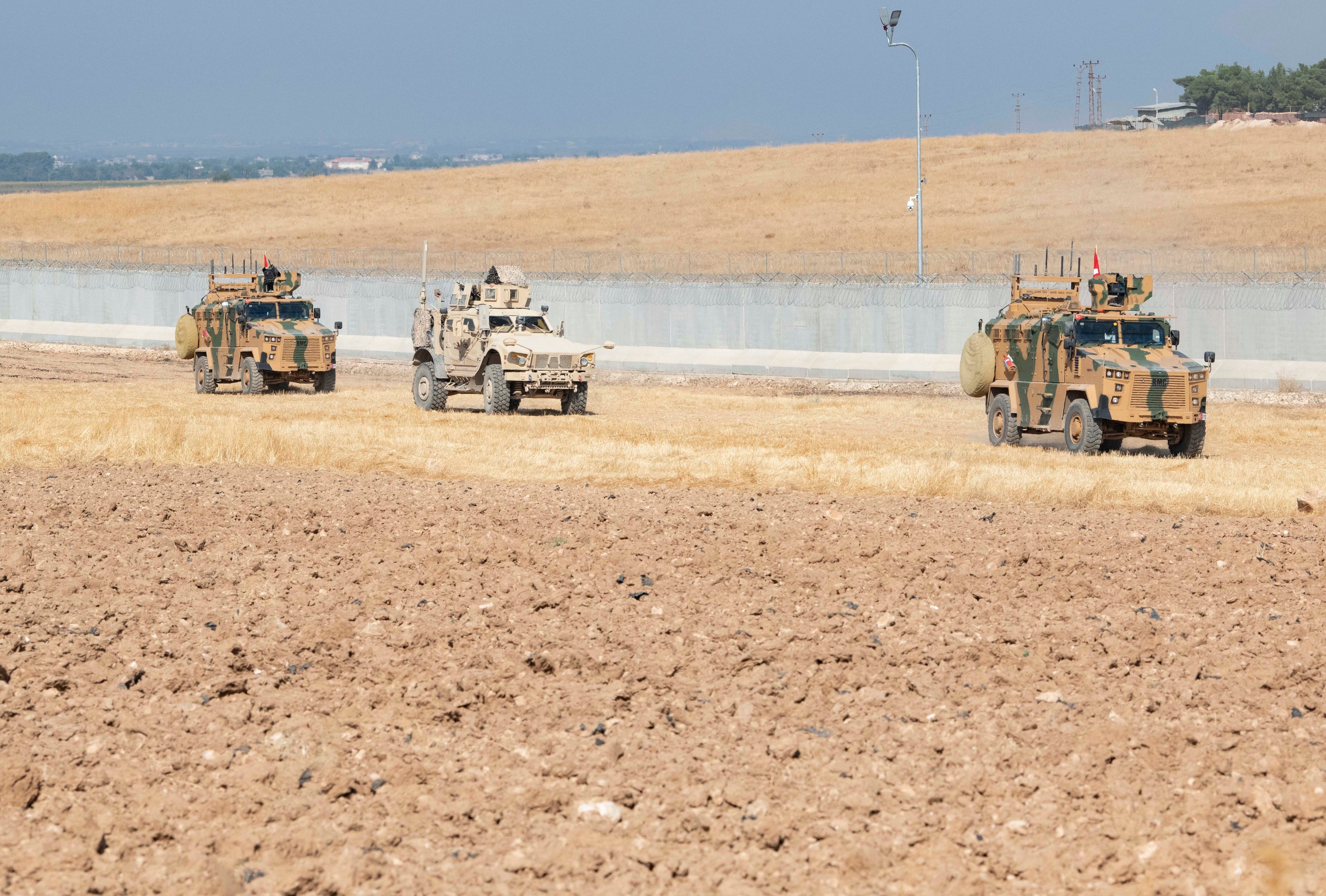 A photo issued on Monday showing US and Turkish military forces in armoured trucks
