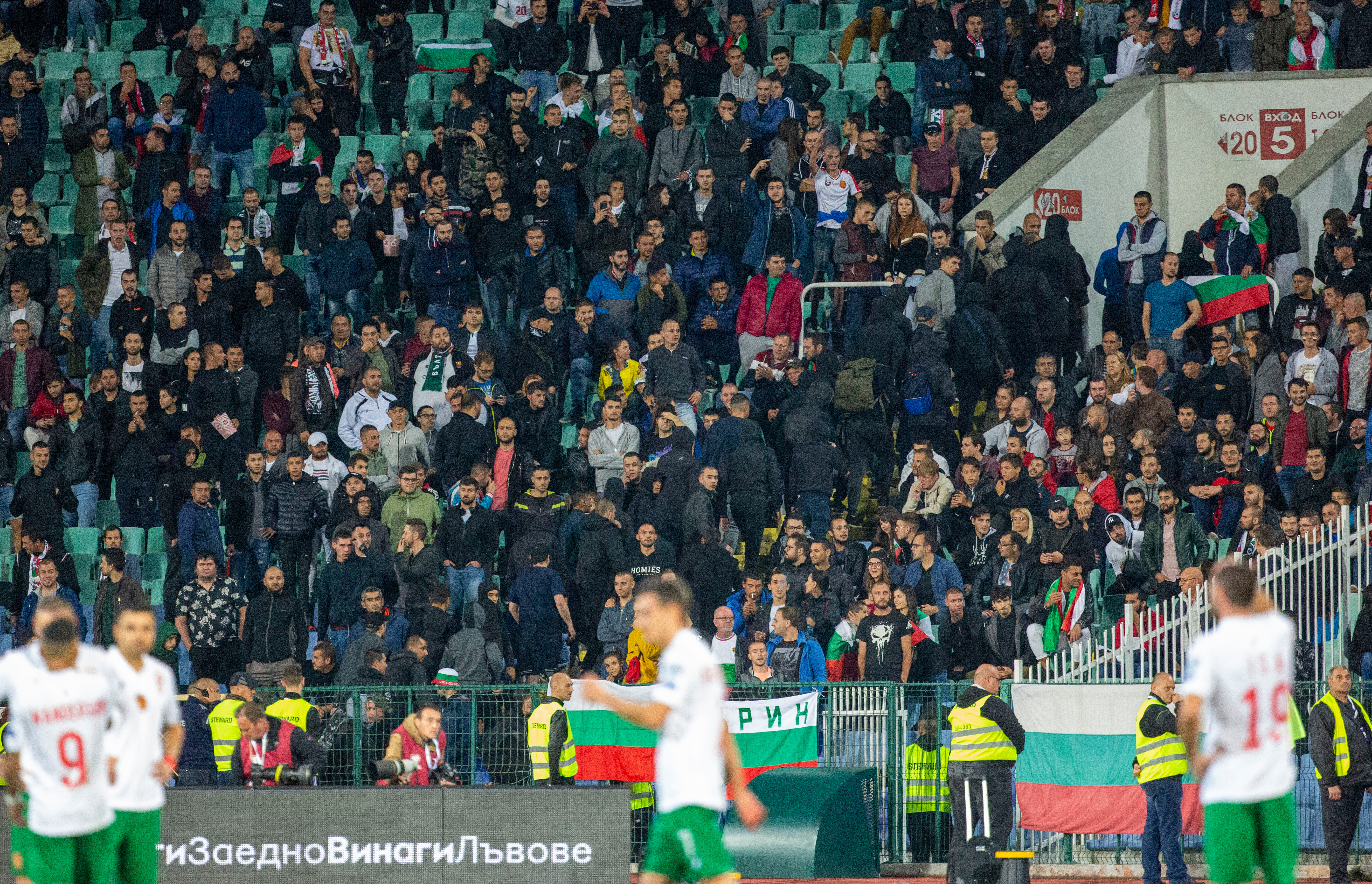 A group of supporters were ordered to leave the stadium at half-time - although racist abuse continued in the second half