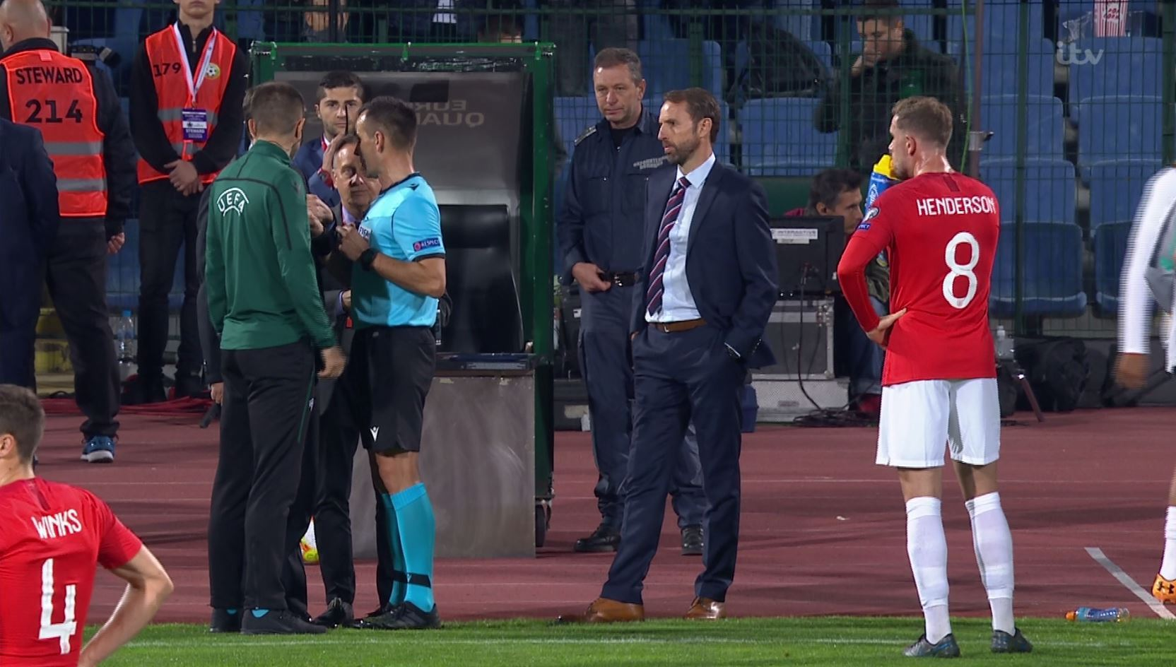Referee Ivan Bebek can be seen talking with the Uefa delegate after a complaint by England players
