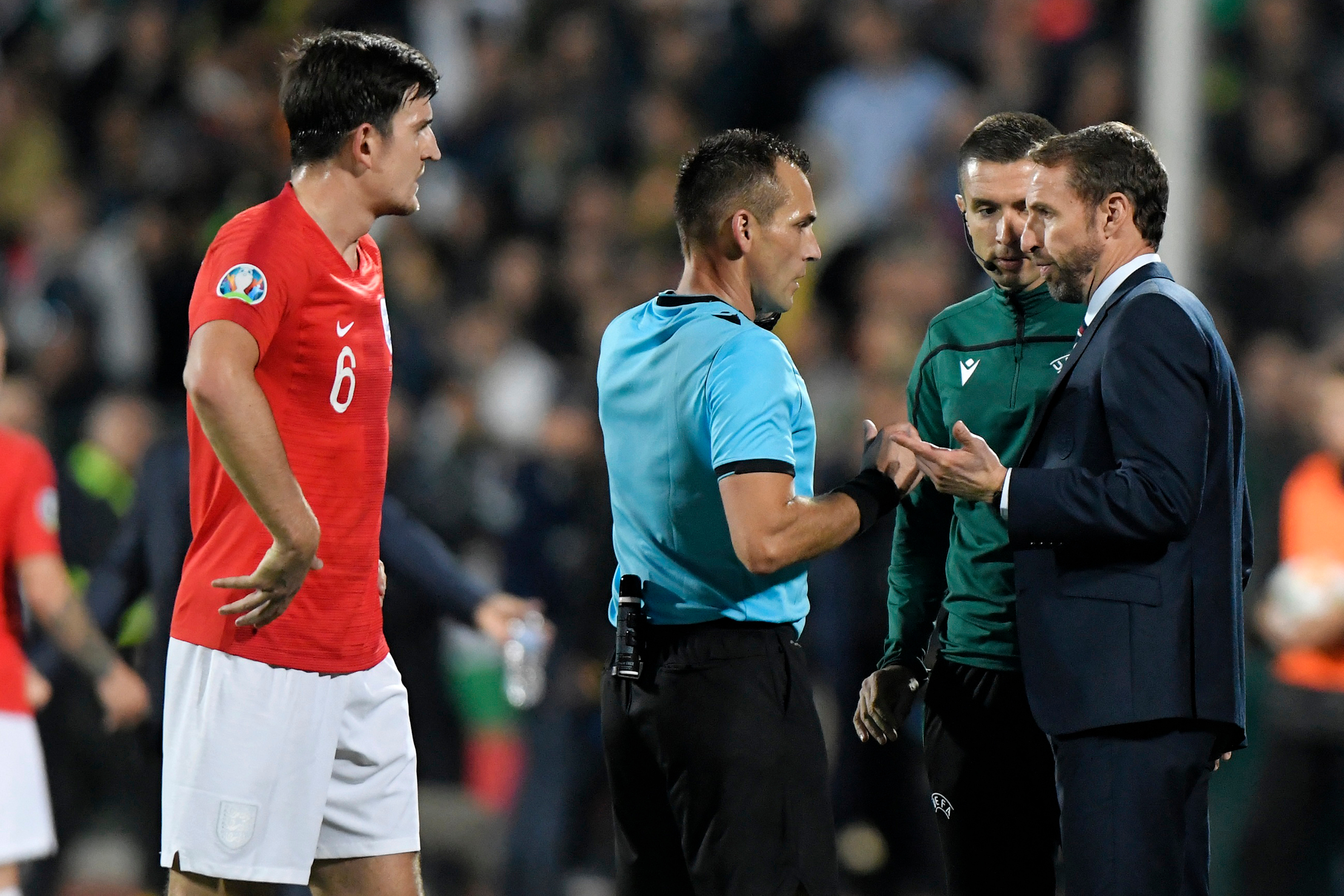 Southgate chats to the referee and Uefa delegate after racist chanting and Nazi salutes in Sofia