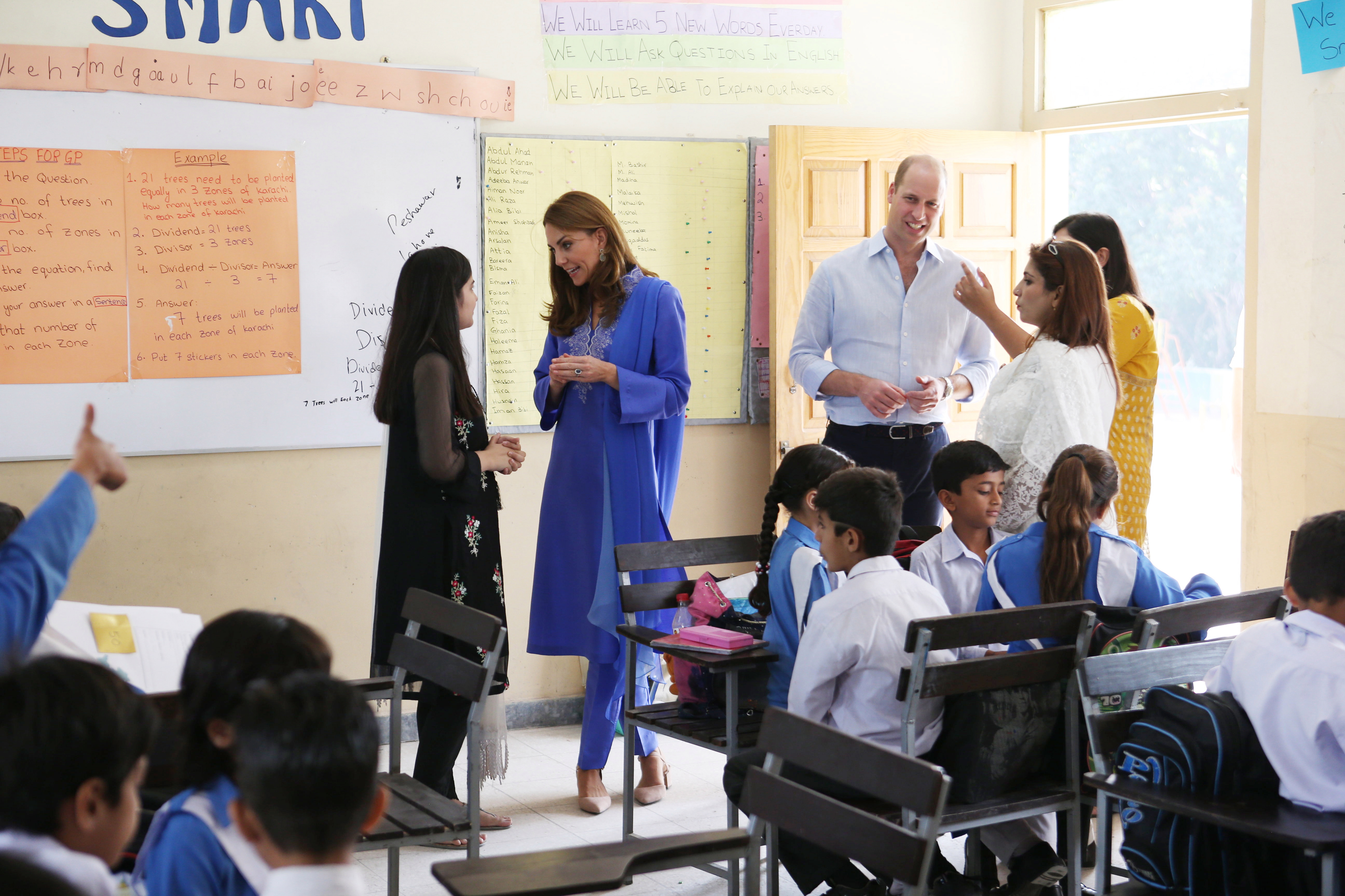 The royals then inspect a classroom