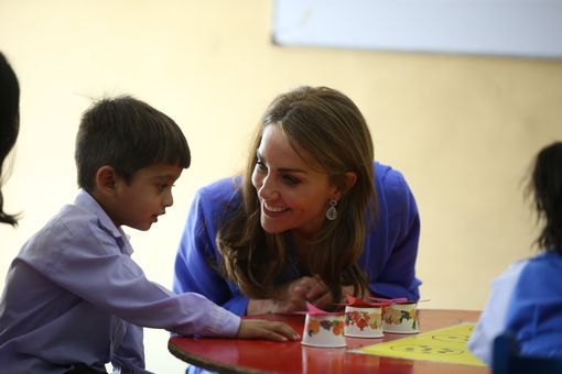 Kate speaks to one child as the royals embark on their first full day of the tour