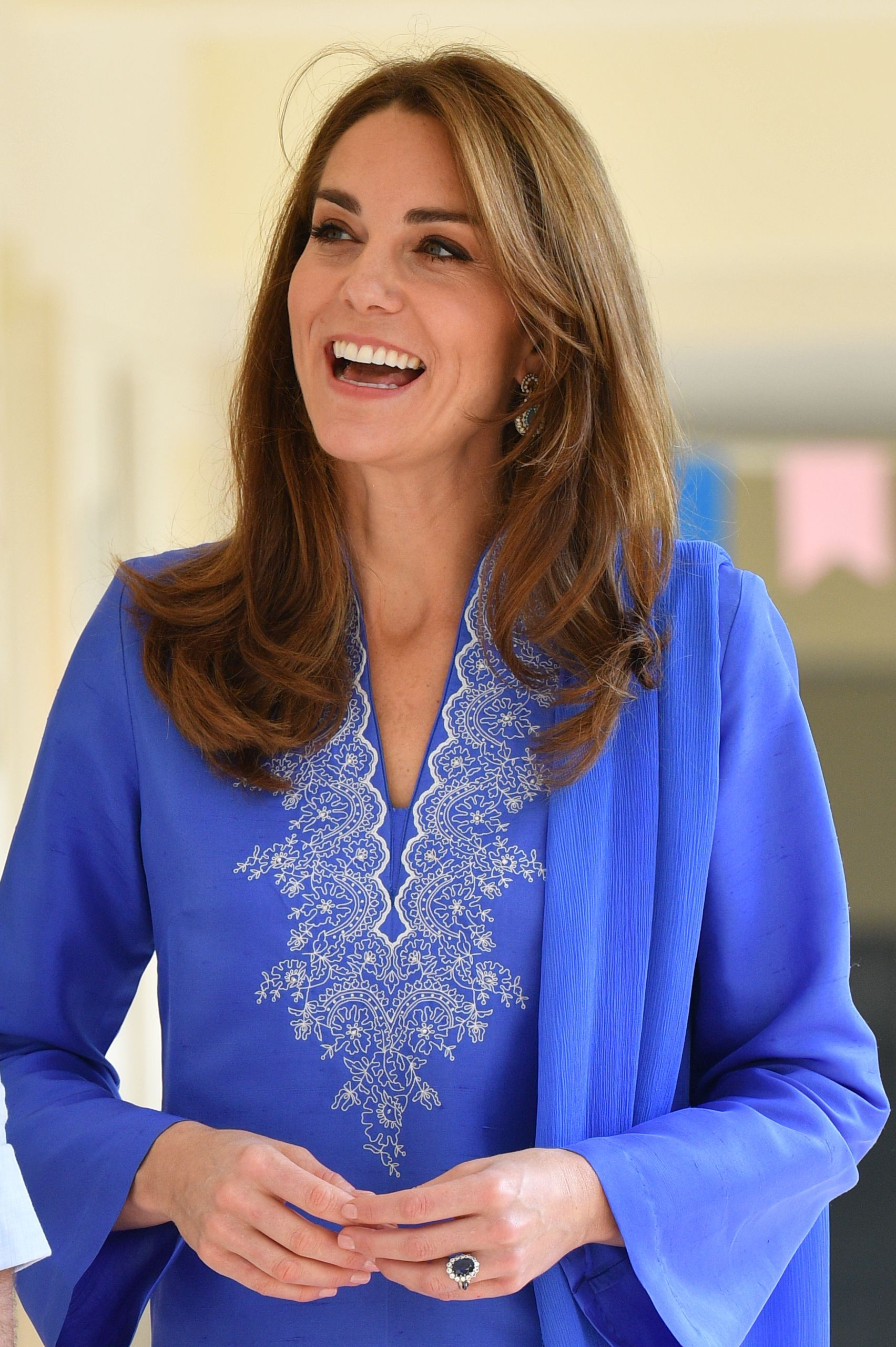 Kate matched her blue outfit and earrings with a ring