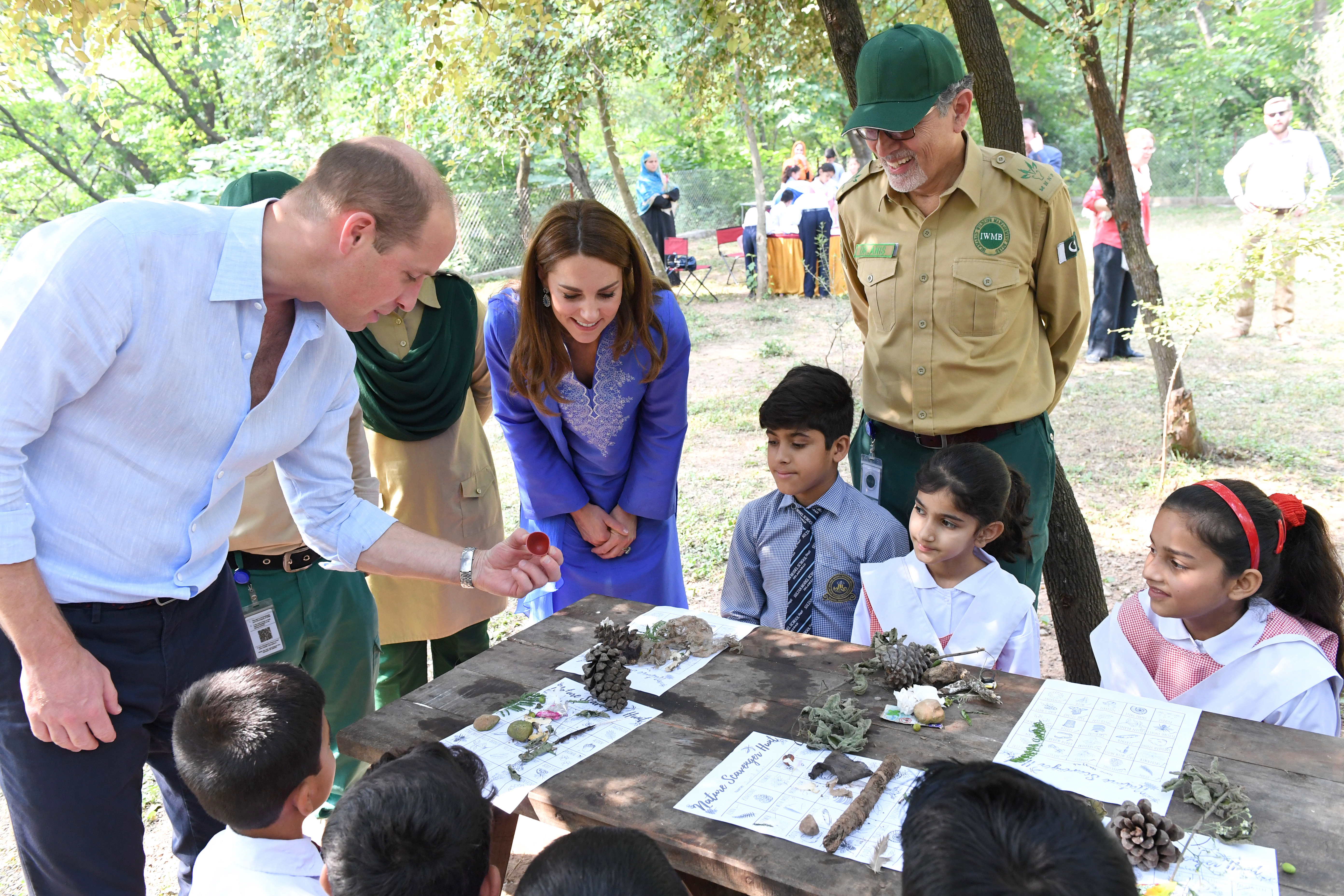 The Duke and Duchess join children to set up a leopard camera trap and help them to identify and remove species of plants that are threatening the natural environment