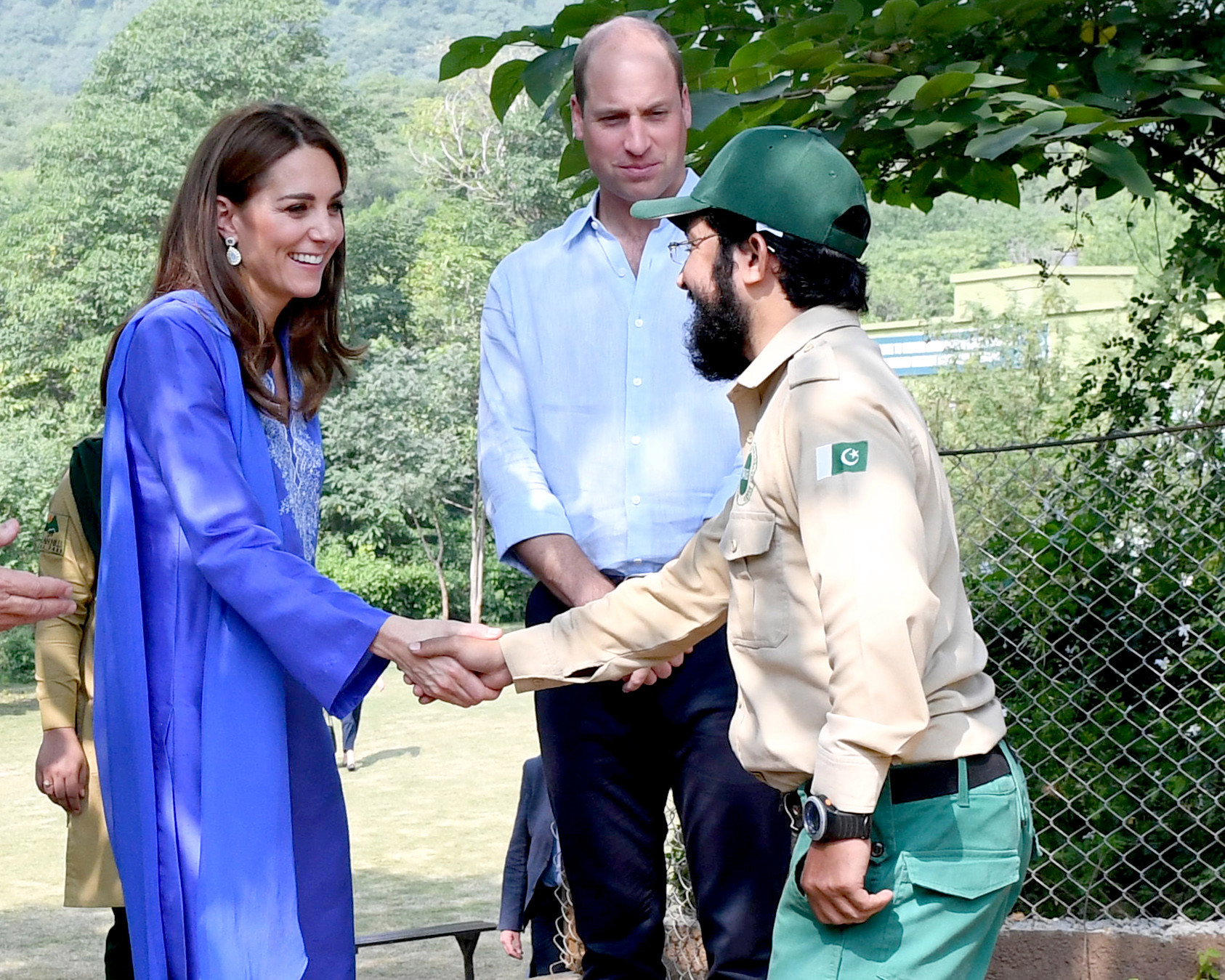 Kate shakes hands with a ranger
