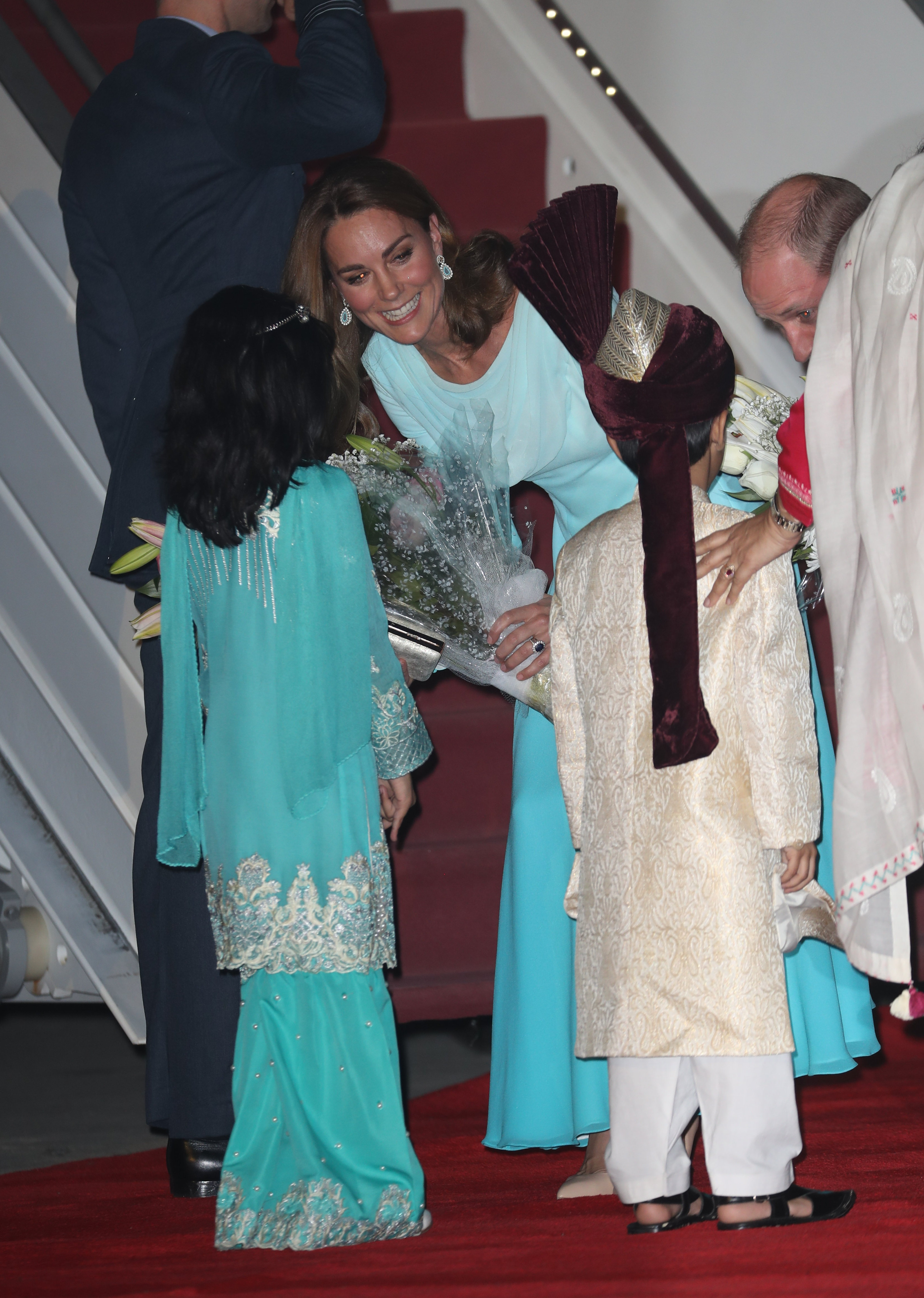 Kate was given flowers by local children in traditional dress