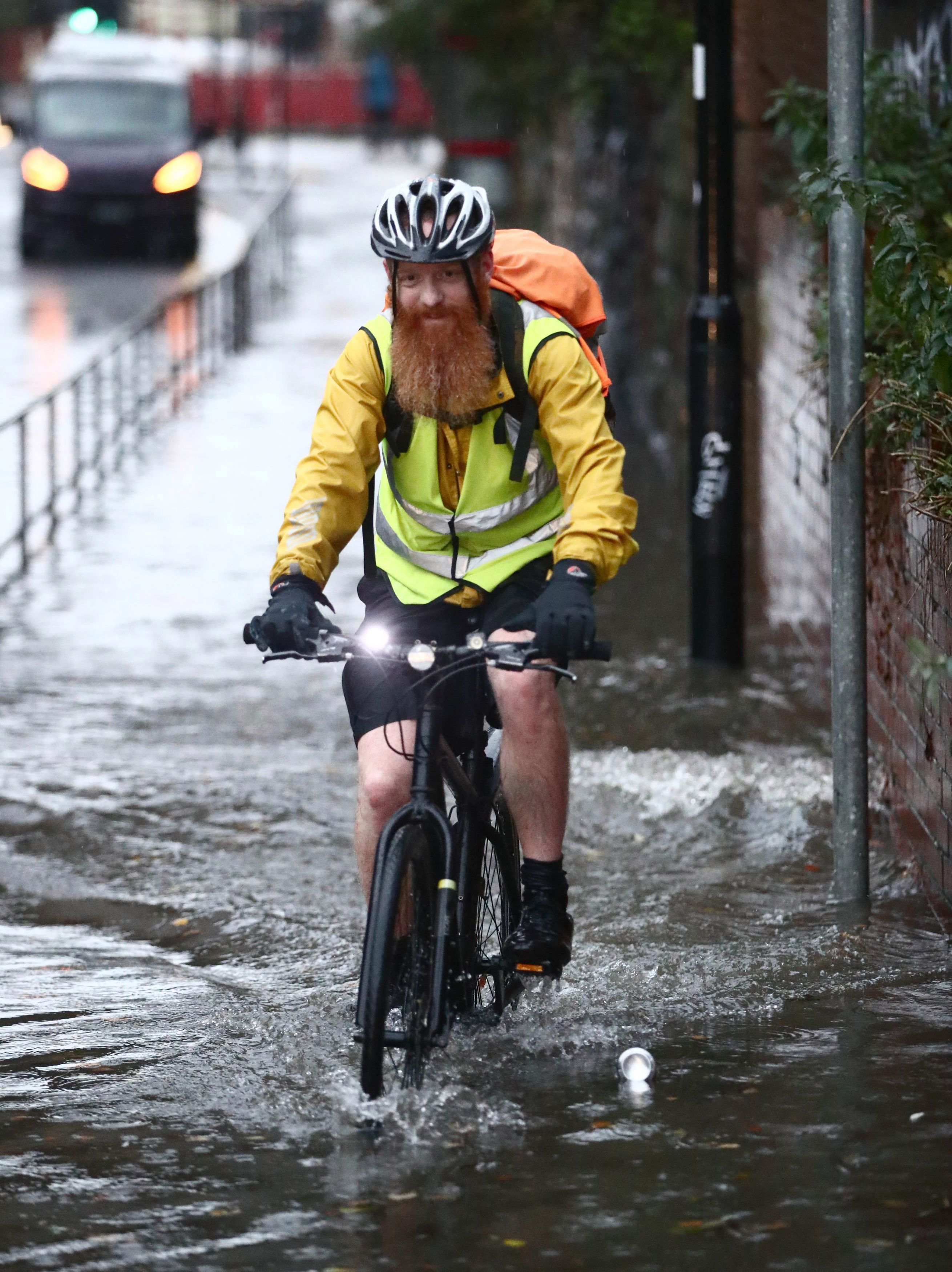 A hardy cyclist in Sheffield takes on the flood water