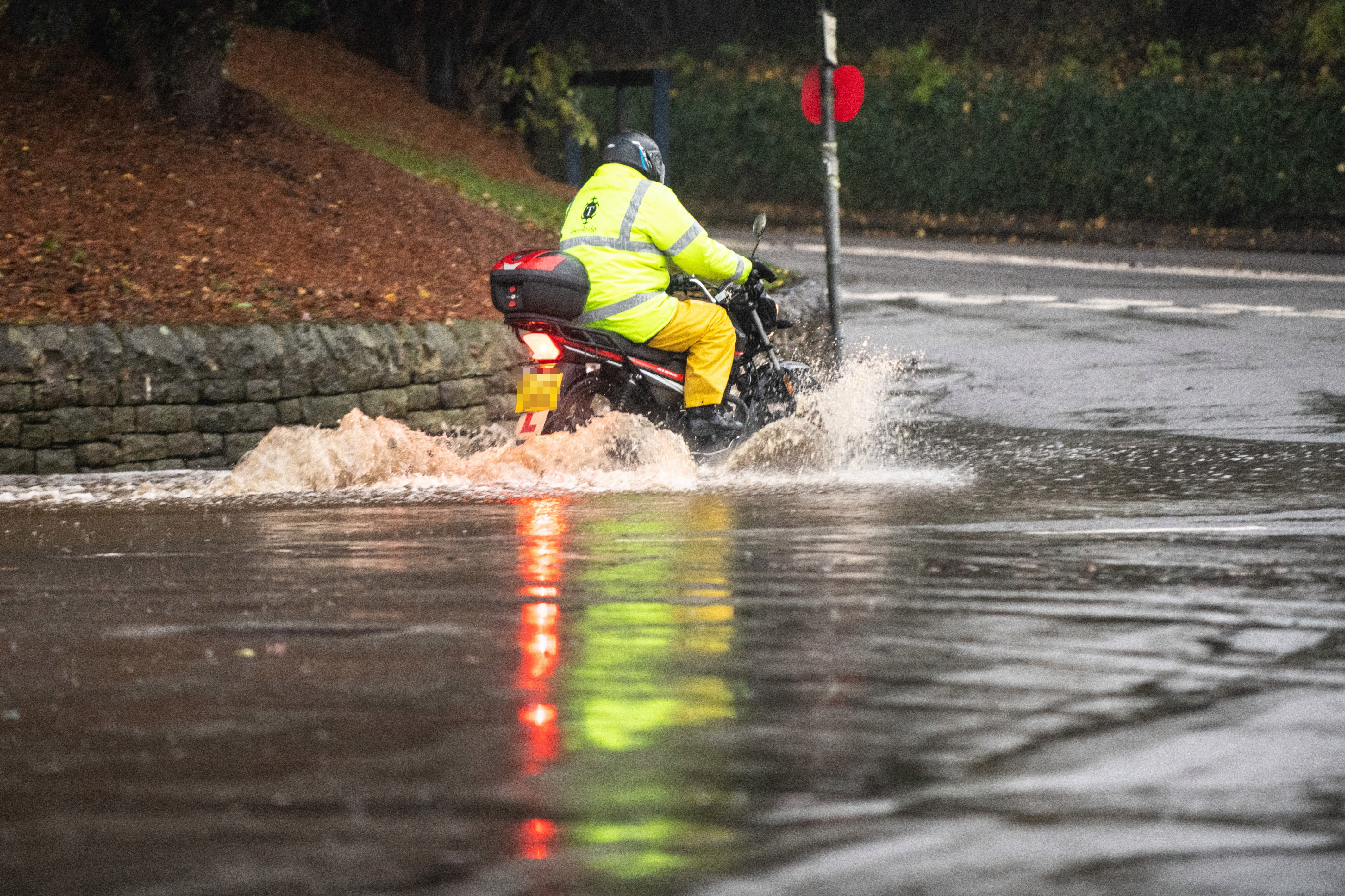 This motorcyclist was prepared for the floods near the Derbyshire village of Bubnell