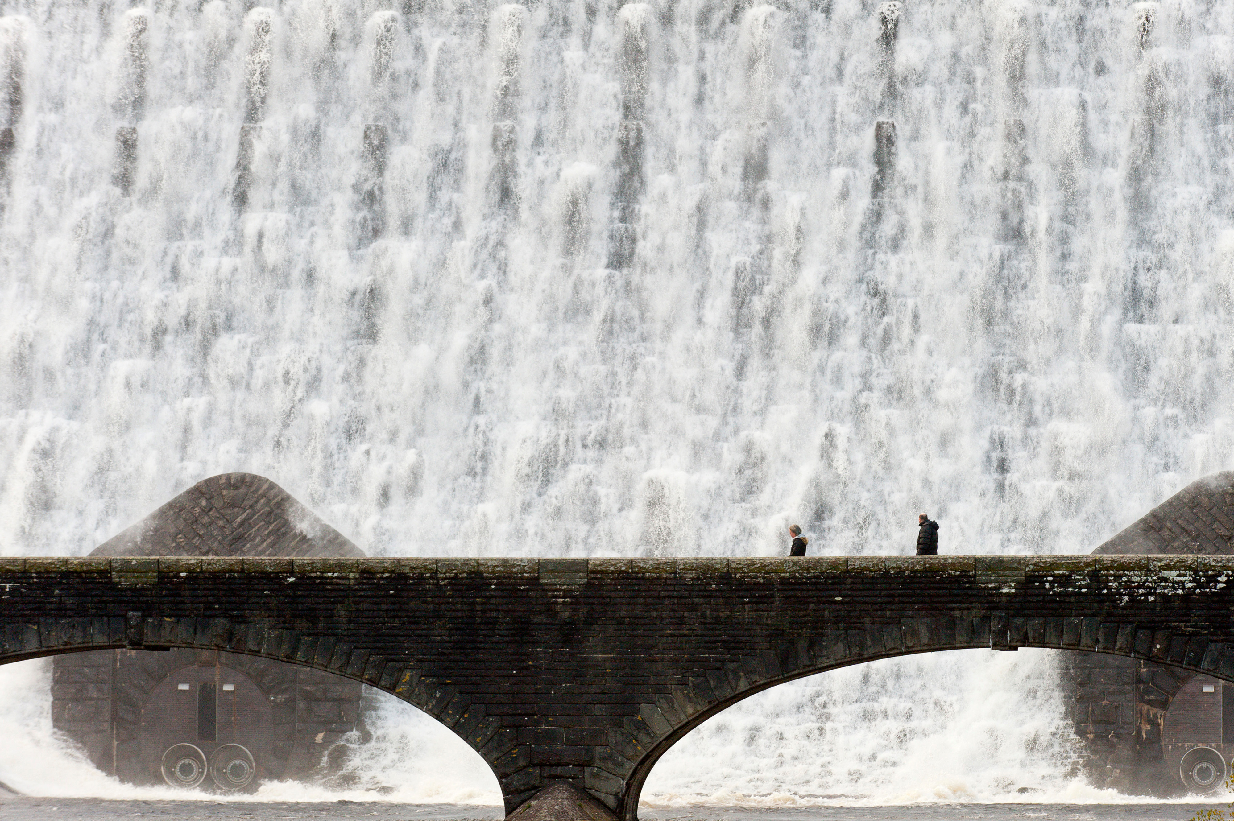 Water cascades over the Caban Coch Dam in Elan Valley, near Rhayader in Powys