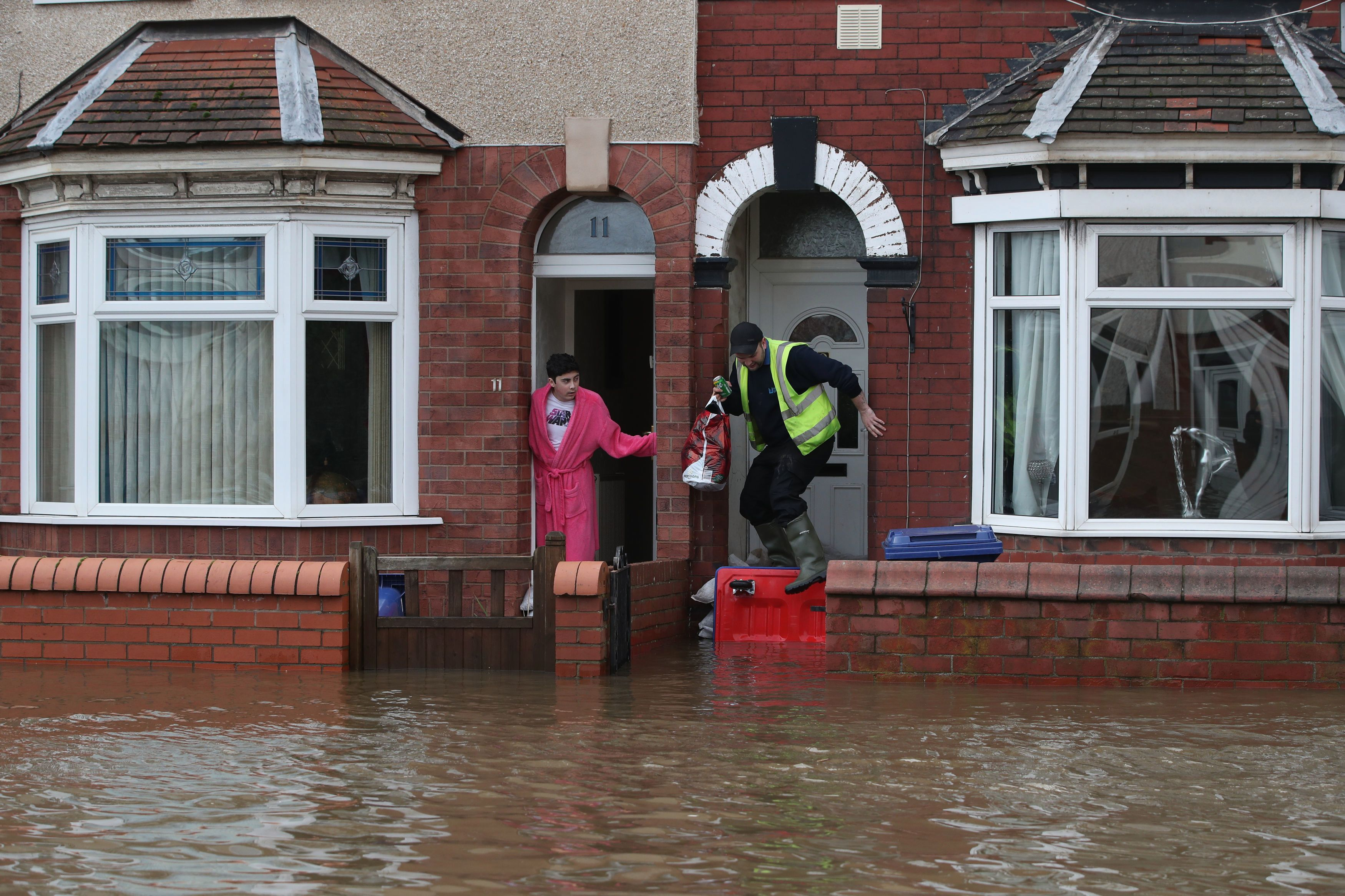 Residents of Yarborough Terrace try to keep the flood waters out of their homes