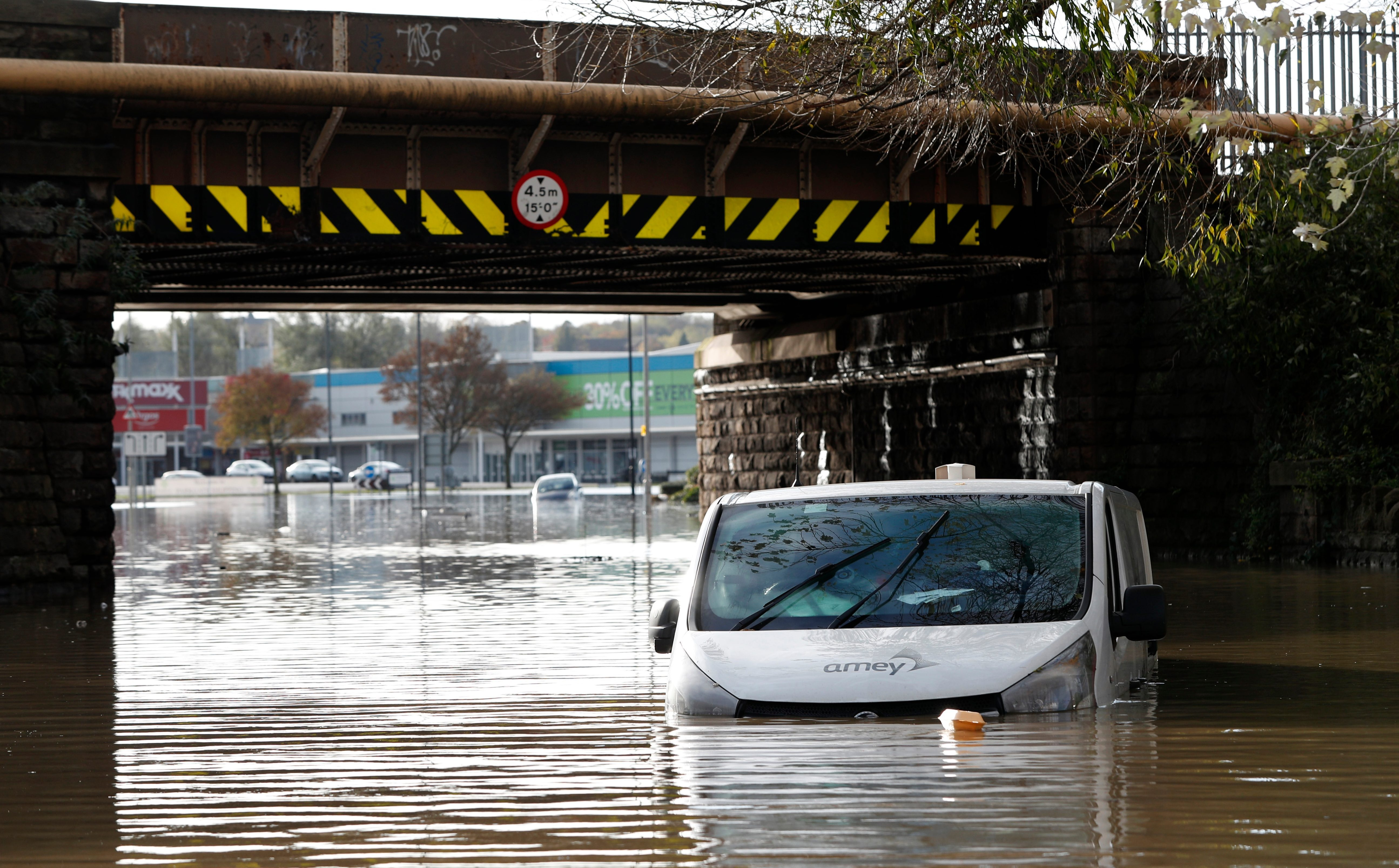 A van stands in flood water after the River Don burst its banks
