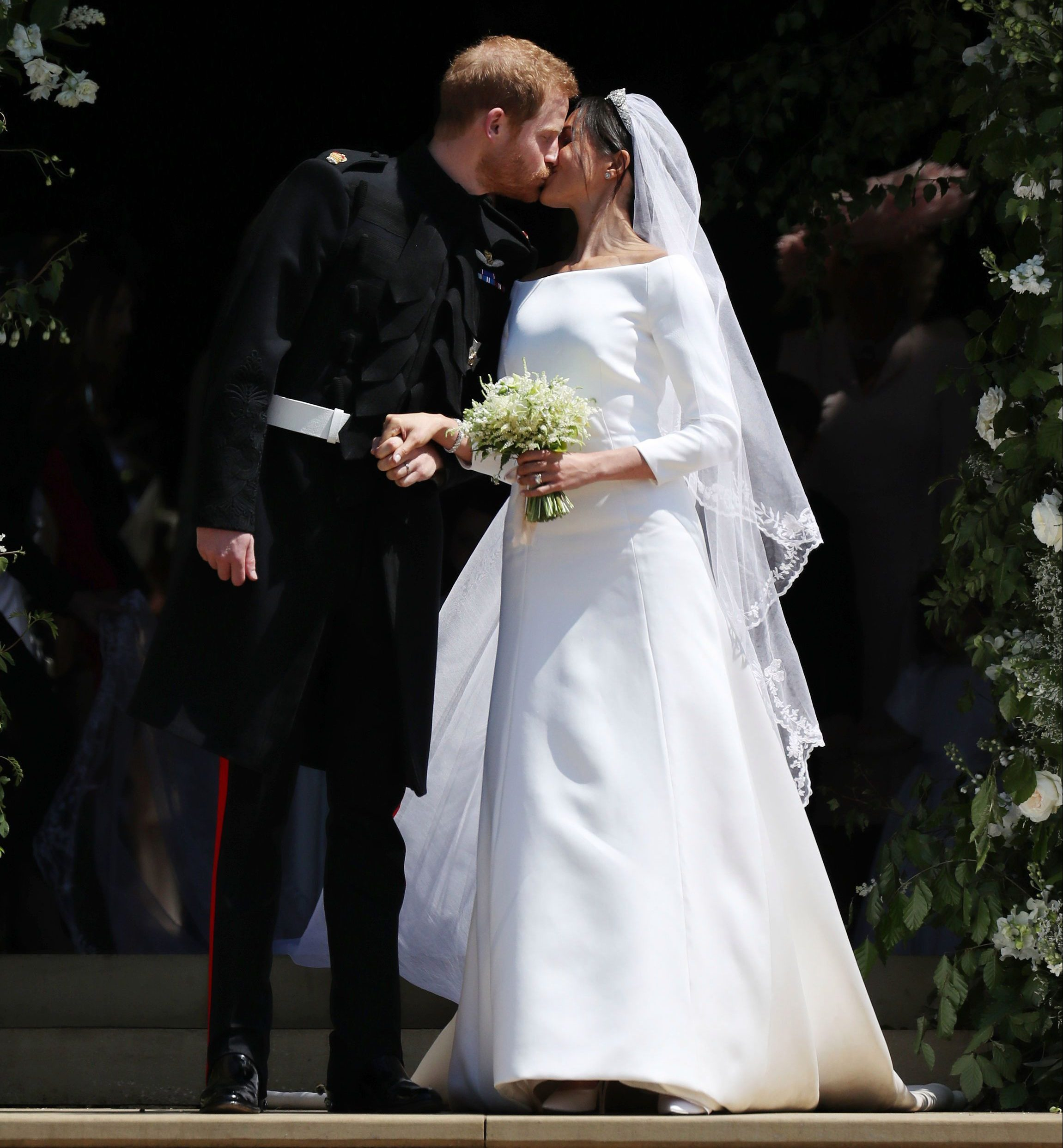 Prince Harry and Meghan Markle kiss on their wedding day in 2018
