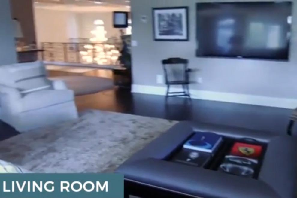 John Cena's living room boasted a giant TV screen and an open space to the landing