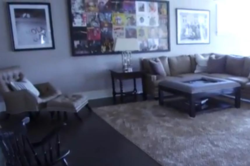 John Cena's living room is quite simplistic with furniture and paintings