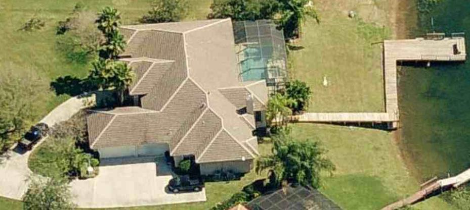 A view of WWE superstar Big Show's mansion from above shows off the cars and pool