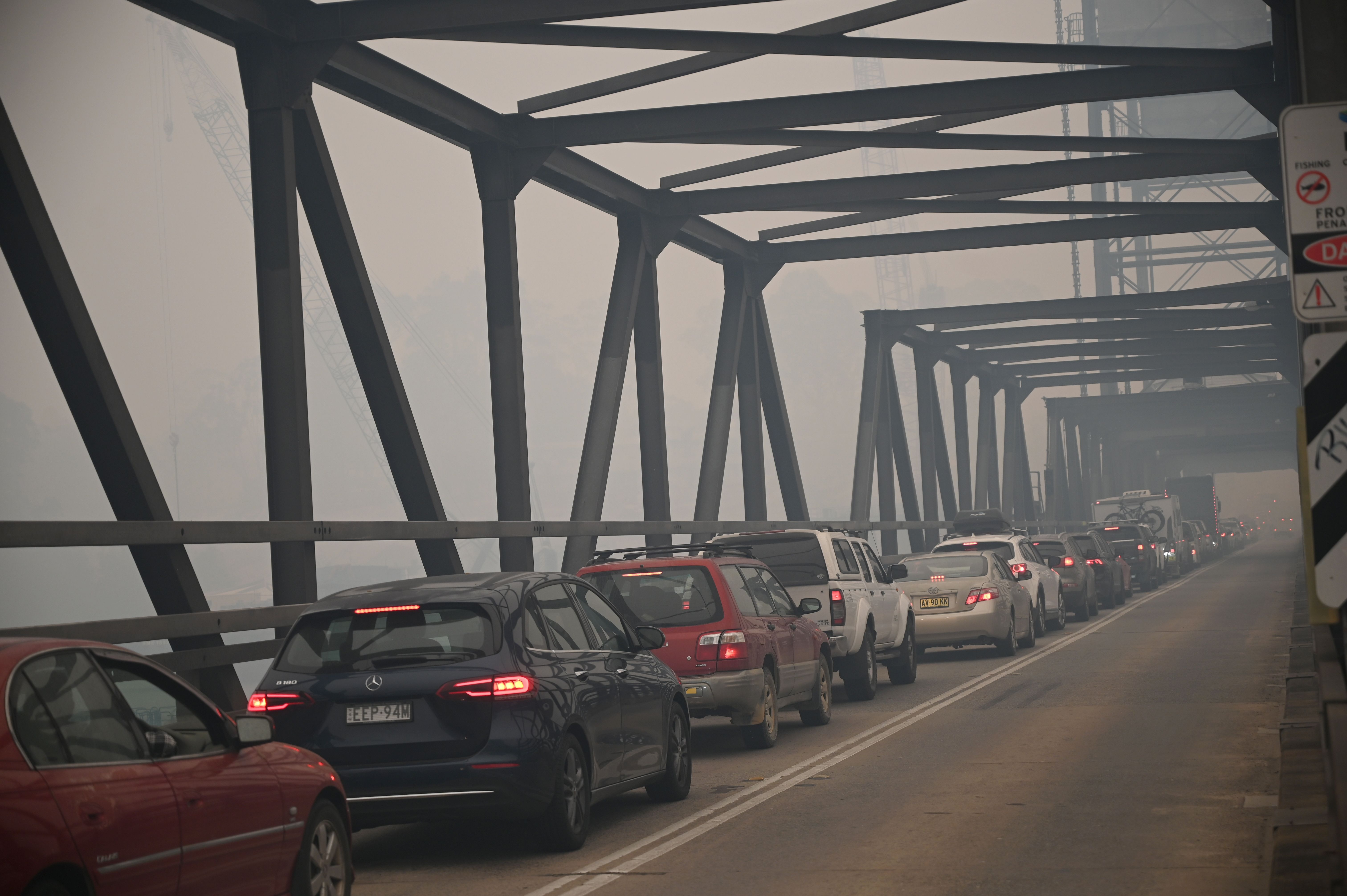 Thousands are trying to flee through choking smoke
