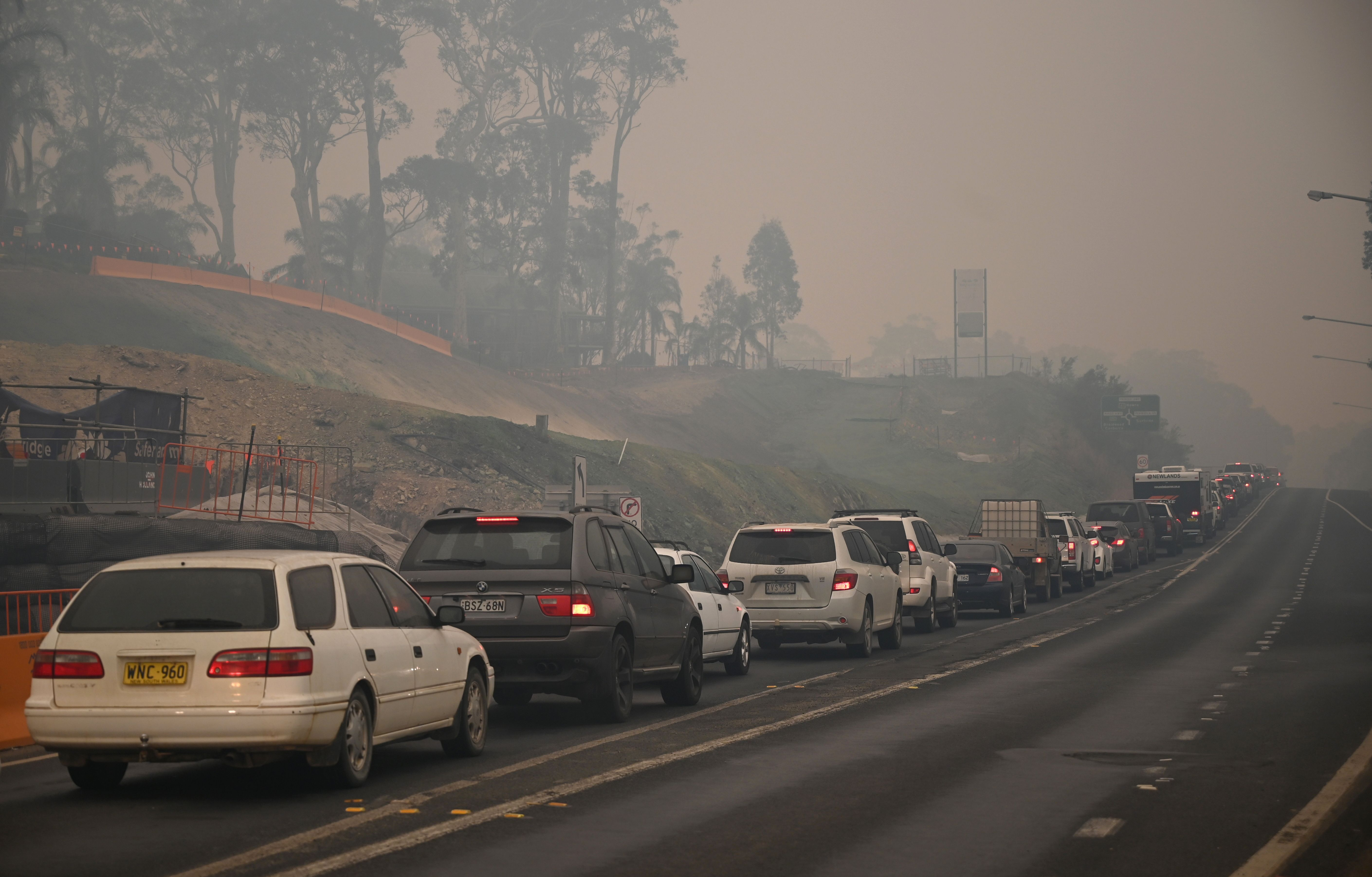 Traffic was jammed on highways out of threatened areas of New South Wales as desperate families and holidaymakers queued to escape