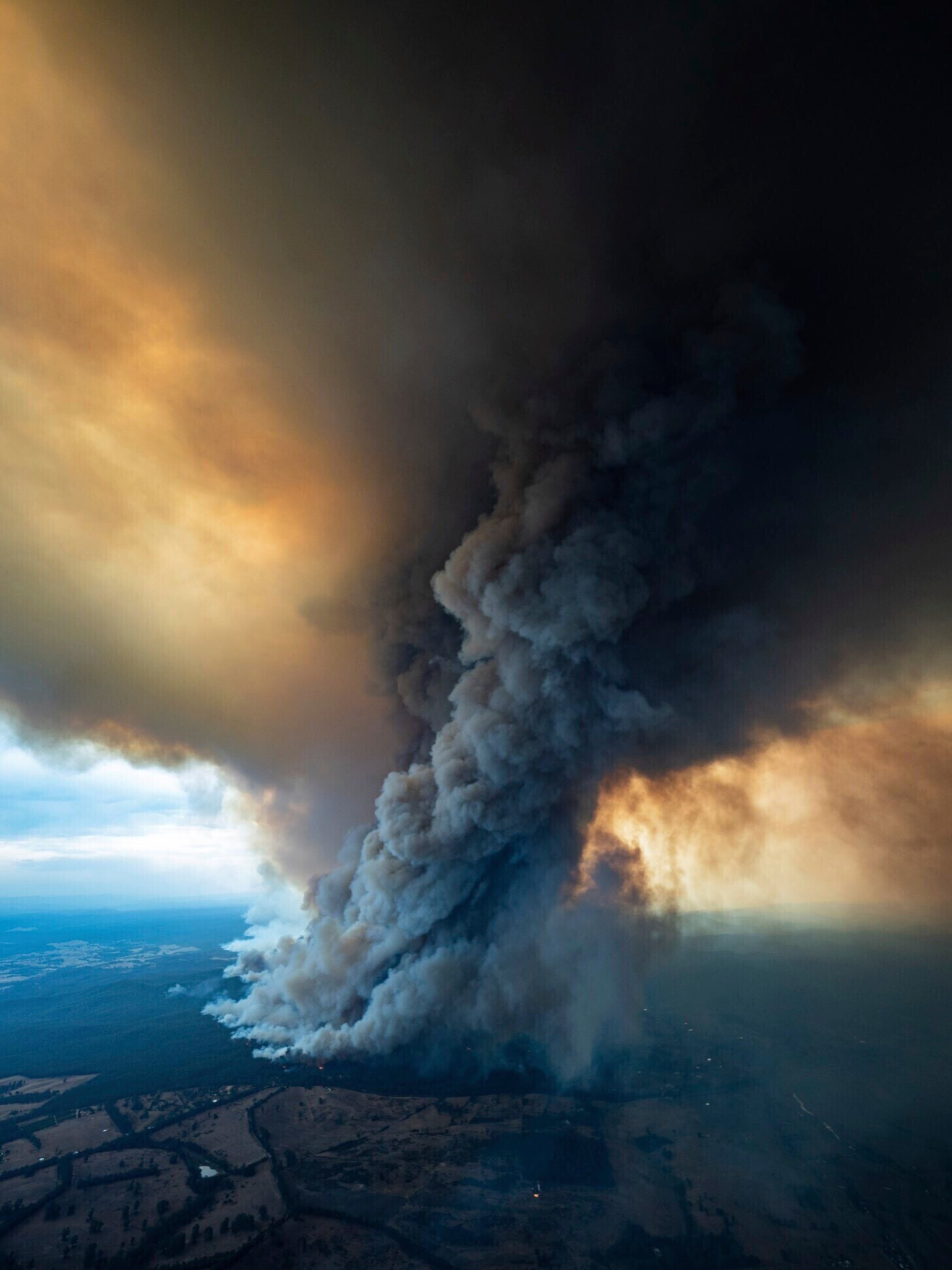 A giant plume of smoke rises from East Gippsland today