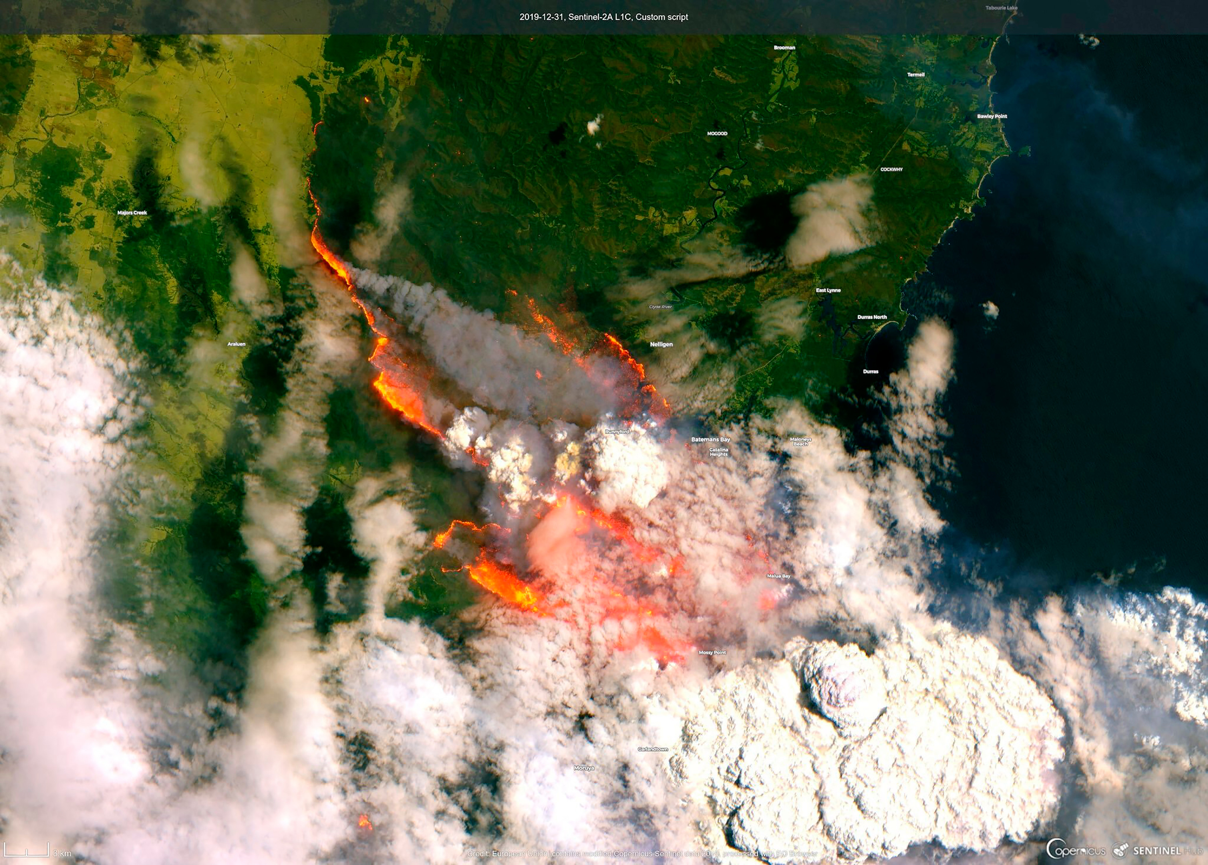 A satellite picture shows the bush fires burning out of control near Bateman's Bay, New South Wales