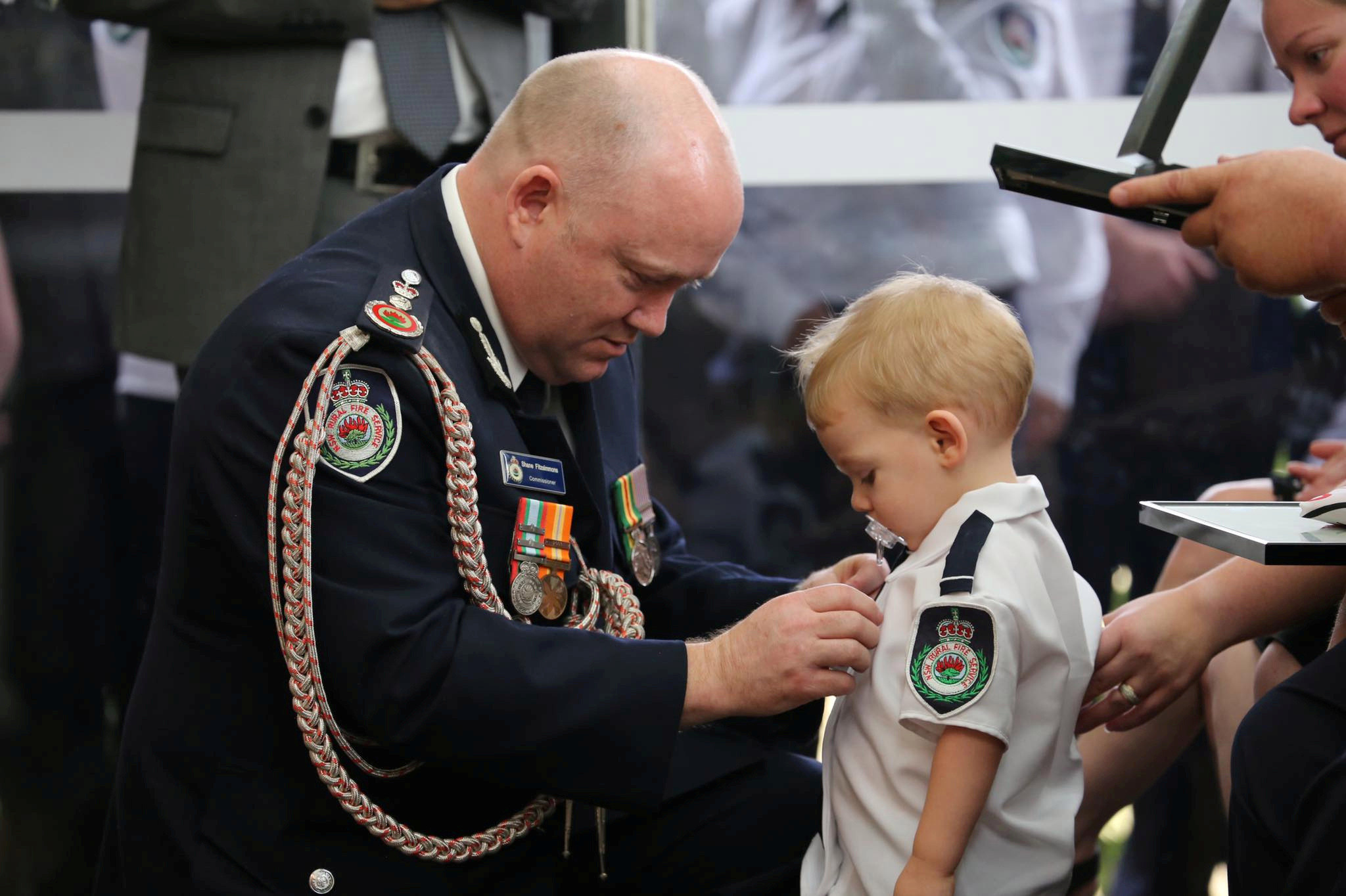 Geoffrey Keaton's young son receives his posthumous bravery medal after he was killed tackling a blaze near Sydney