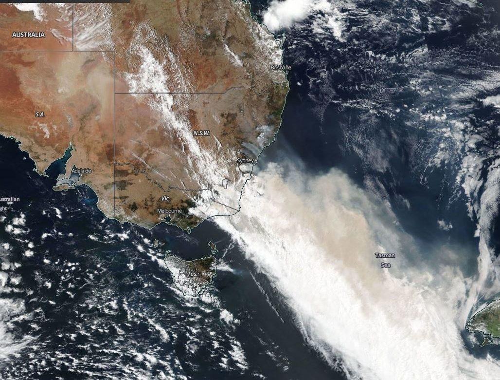 A Nasa satellite image shows smoke clouds stretching hundreds of miles across the Tasman Sea