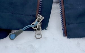 This photo shows a closeup of the main center zipper on the Stio Environ Jacket.