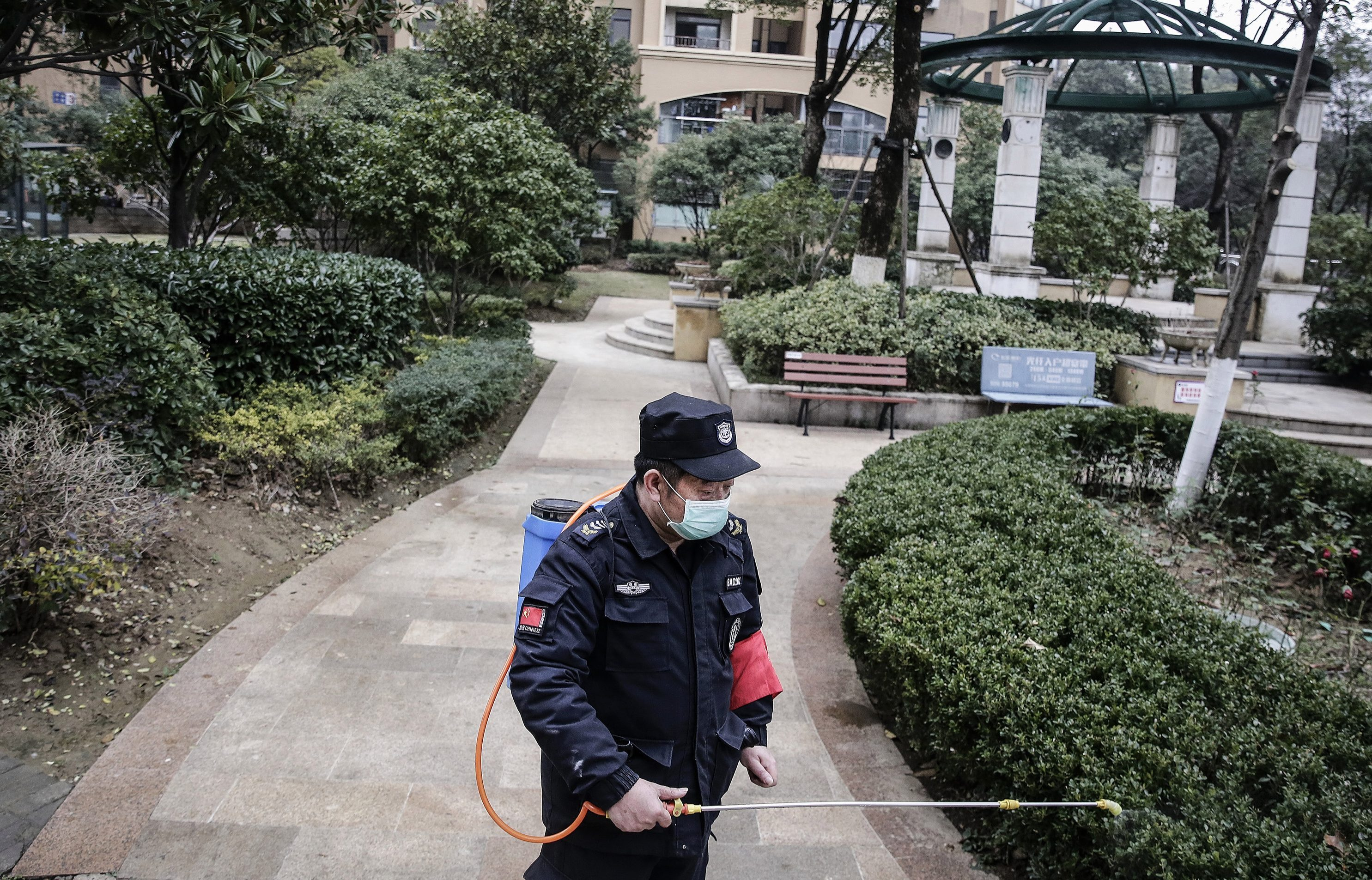 A man is using alcohol to disinfect a community in Wuhan after the city has been placed on lockdown