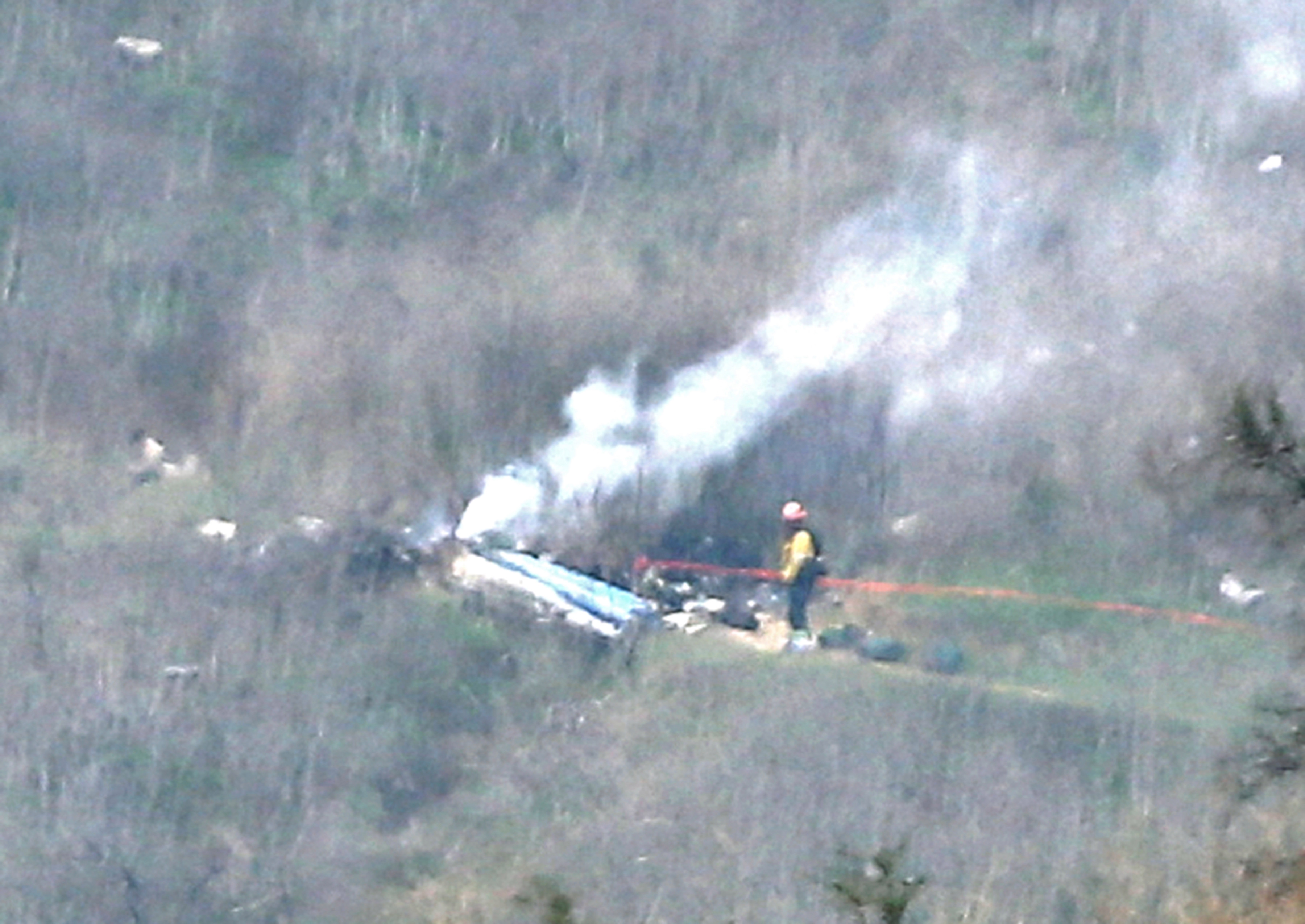 The remains of the helicopter can be seen in this picture