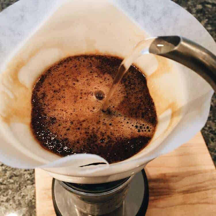 Controlled water pouring over ground coffee
