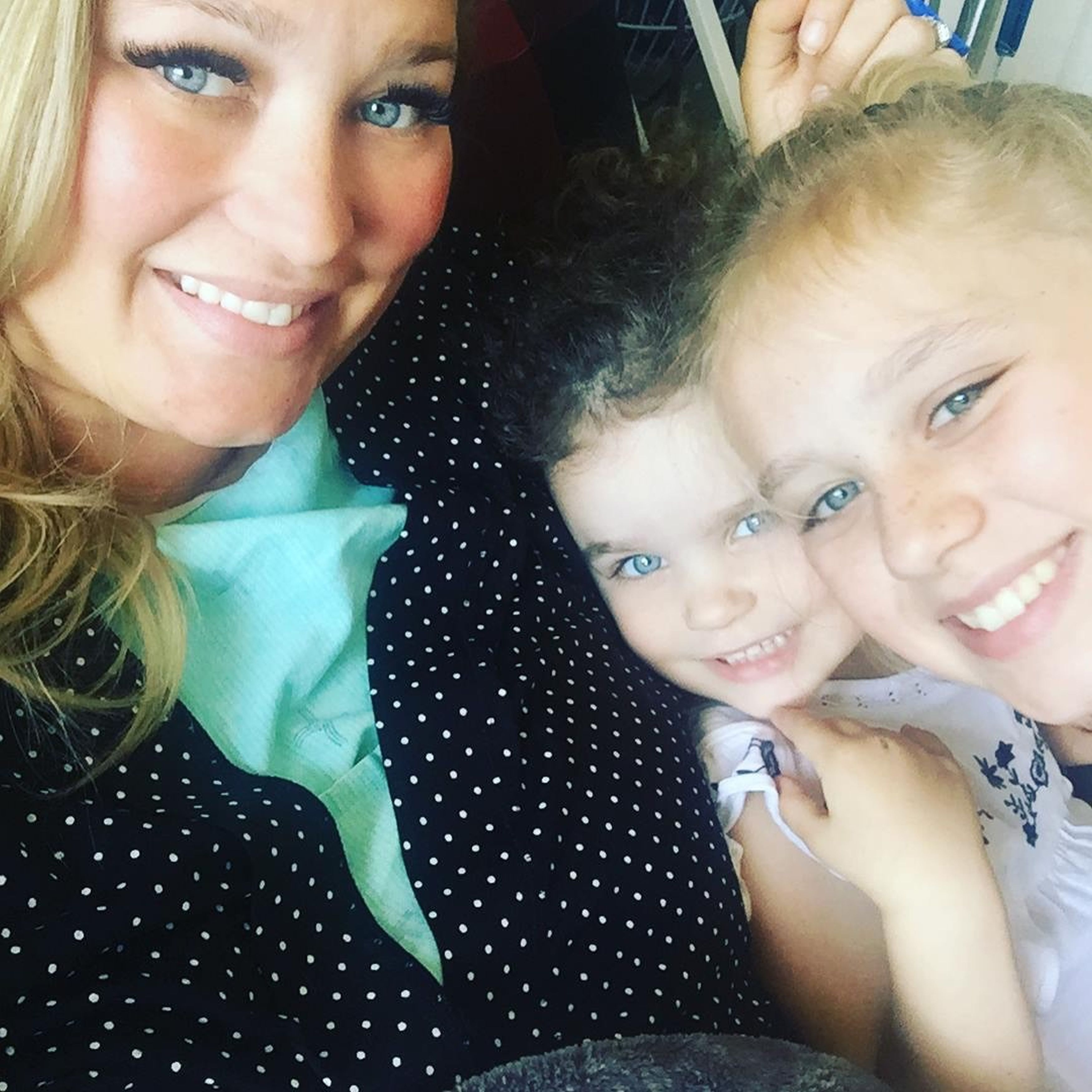Kelsey, pictured with her children Brooke and Scarlet, needed a seat belt extension when she took a plane