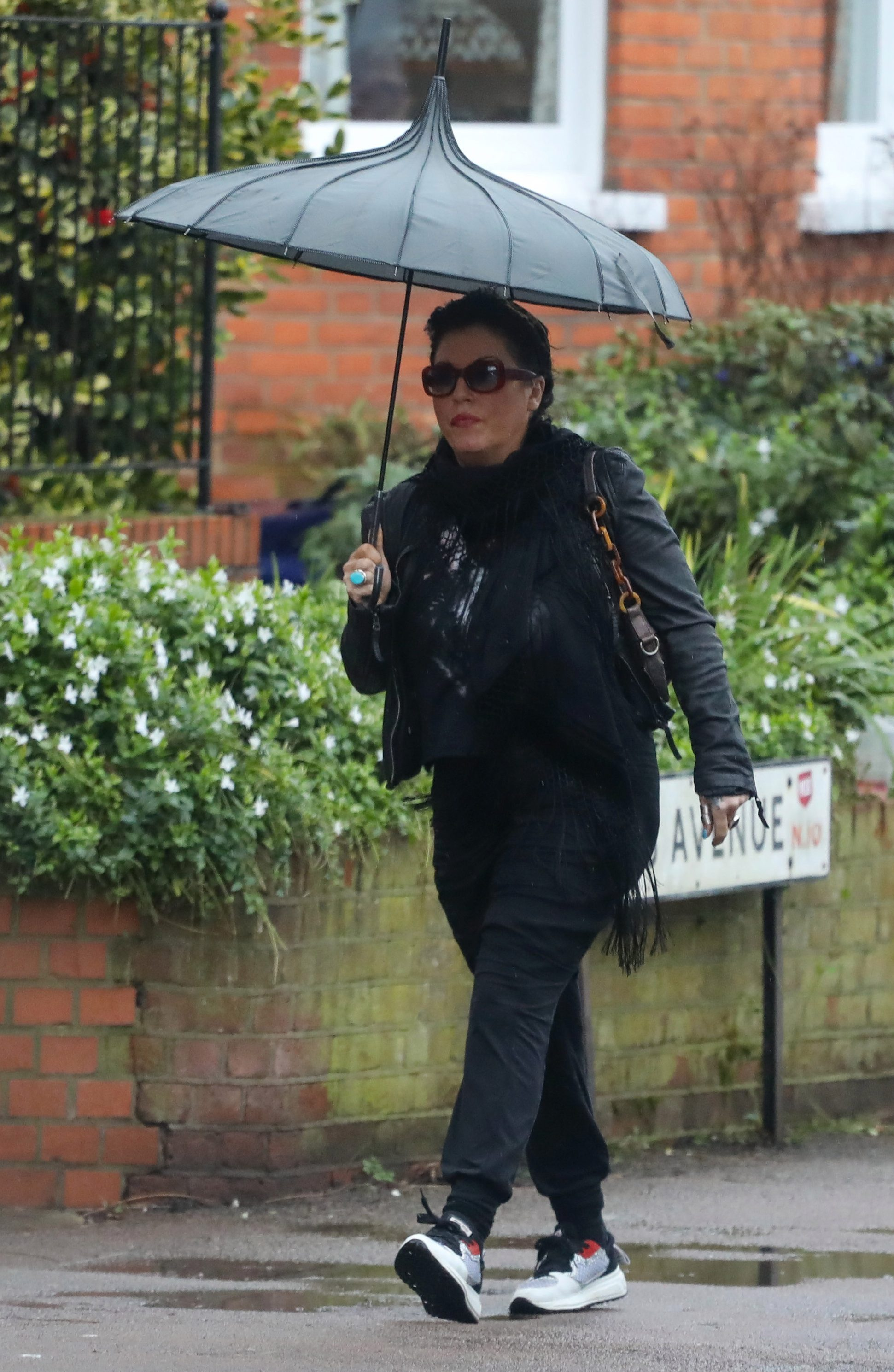 Jessie hides behind sunglasses as she is pictured for the first time since her suspension