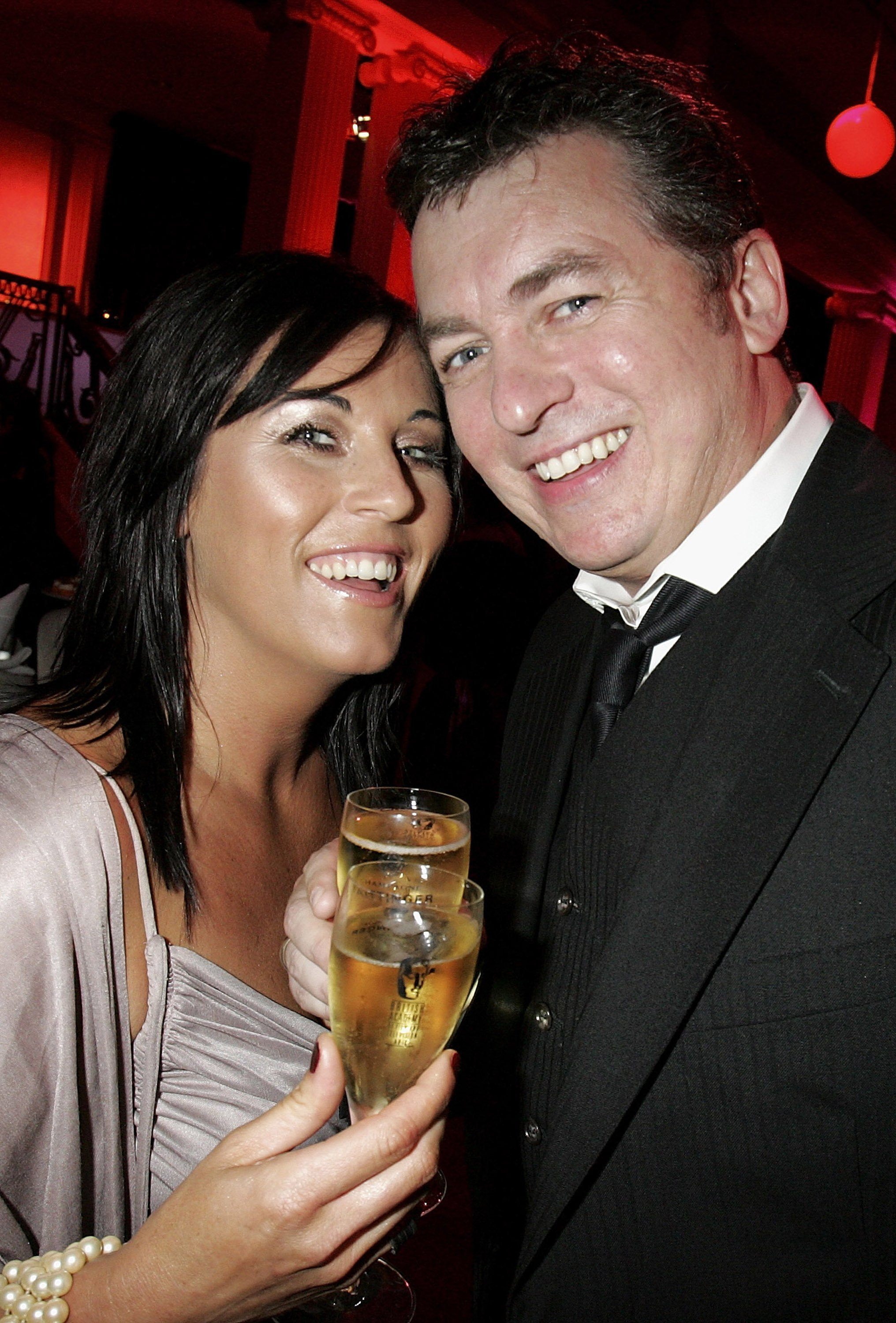 The soap star attends a champagne reception with actor Shane Richie, who played her on-screen husband Alfie Moon, in 2006