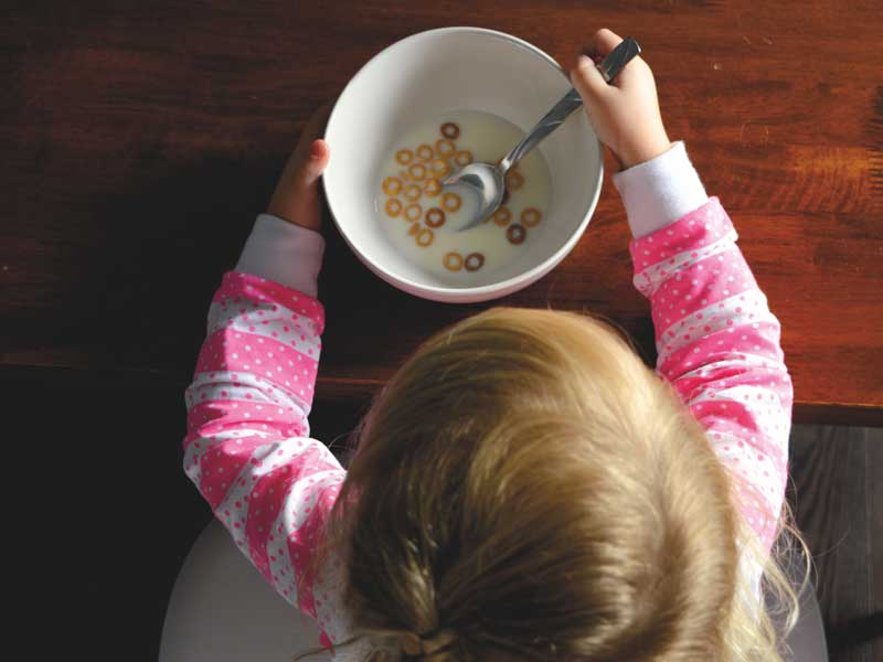 Safe Baby Healthy Child post on organic turkey Thanksgiving avoid GMO girl eating cereal