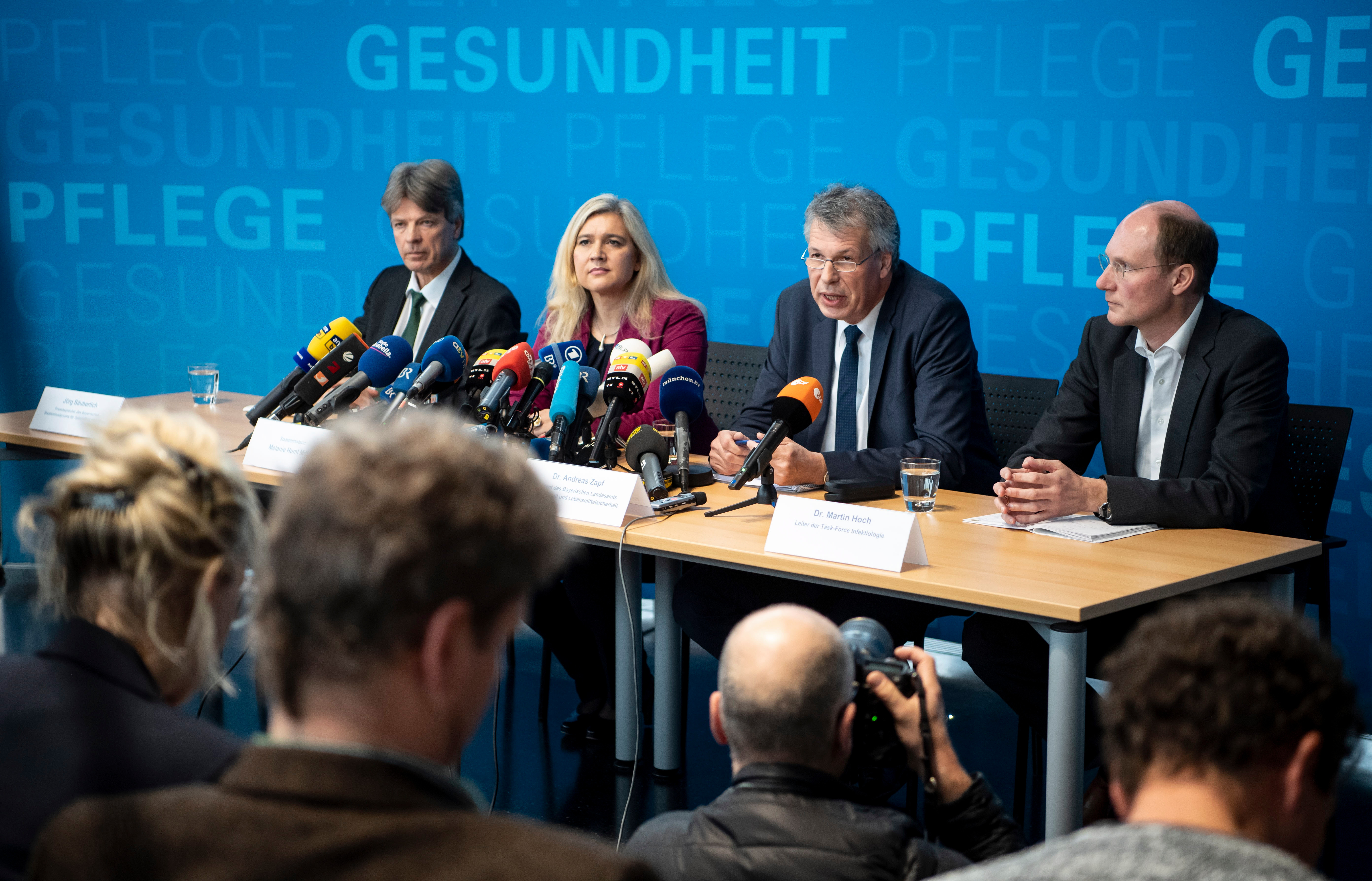 President of the Bavarian state office for health and food safety, Andreas Zapf (third left), speaks next to Bavarian Health Minister Melanie Huml (second left), during a news conference in Munich