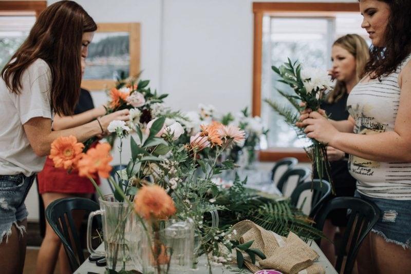 Bridesmaids assembling bouquets