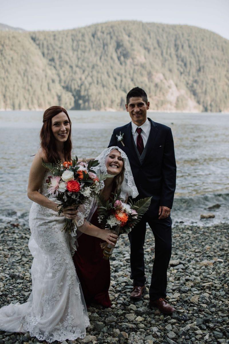 Bridesmaid hiding in bride's dress