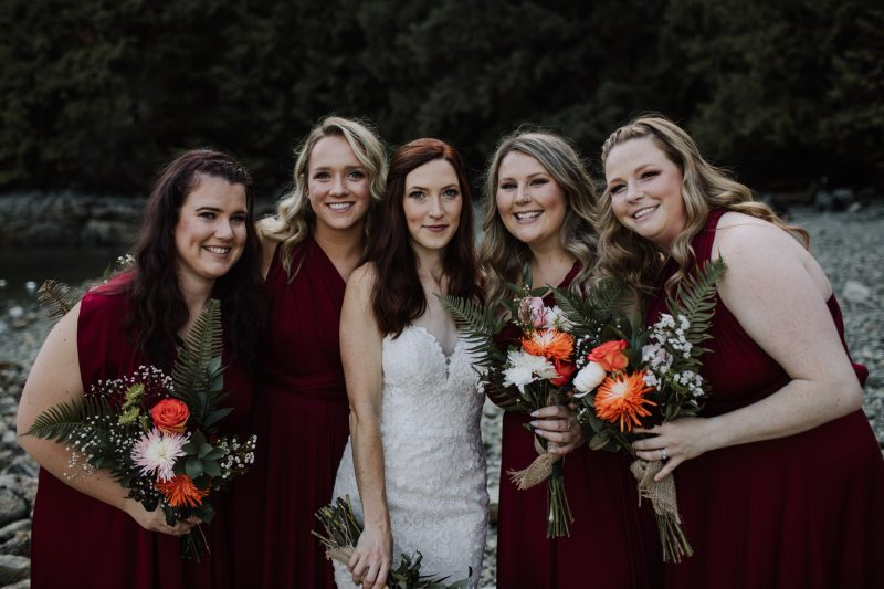 Bride and bridesmaids smiling