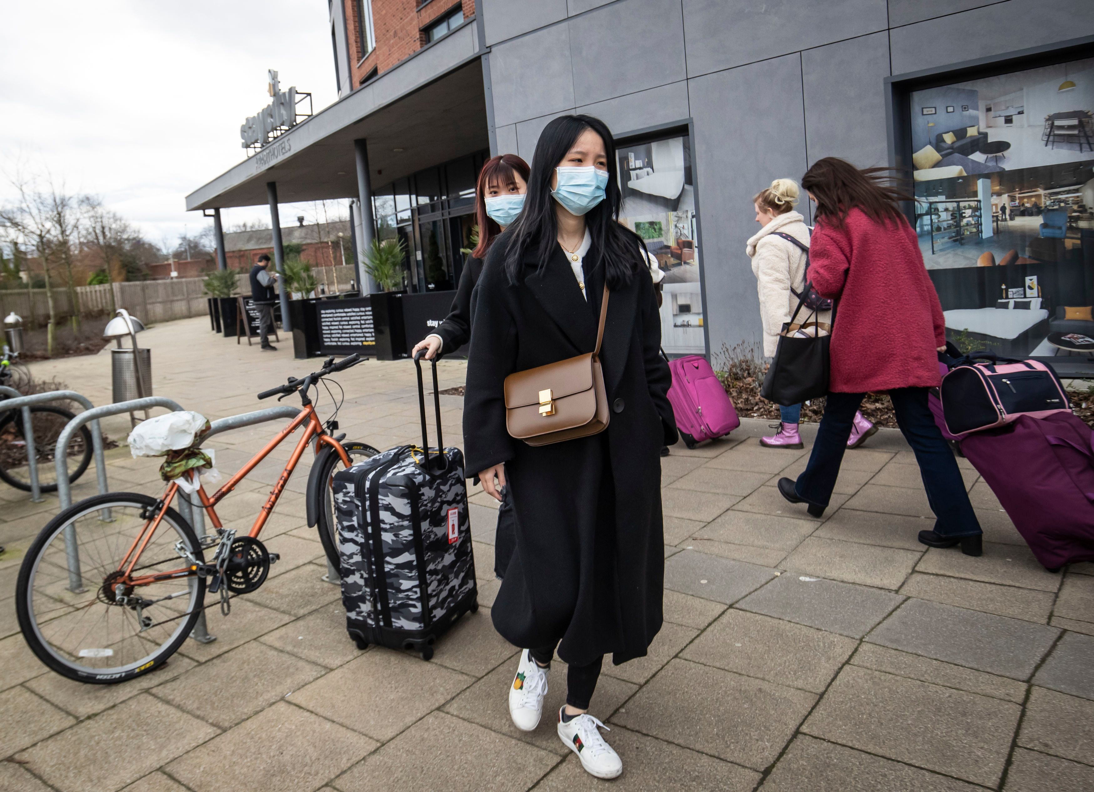 Two women wearing face masks leave the Staycity Hotel in the centre of York